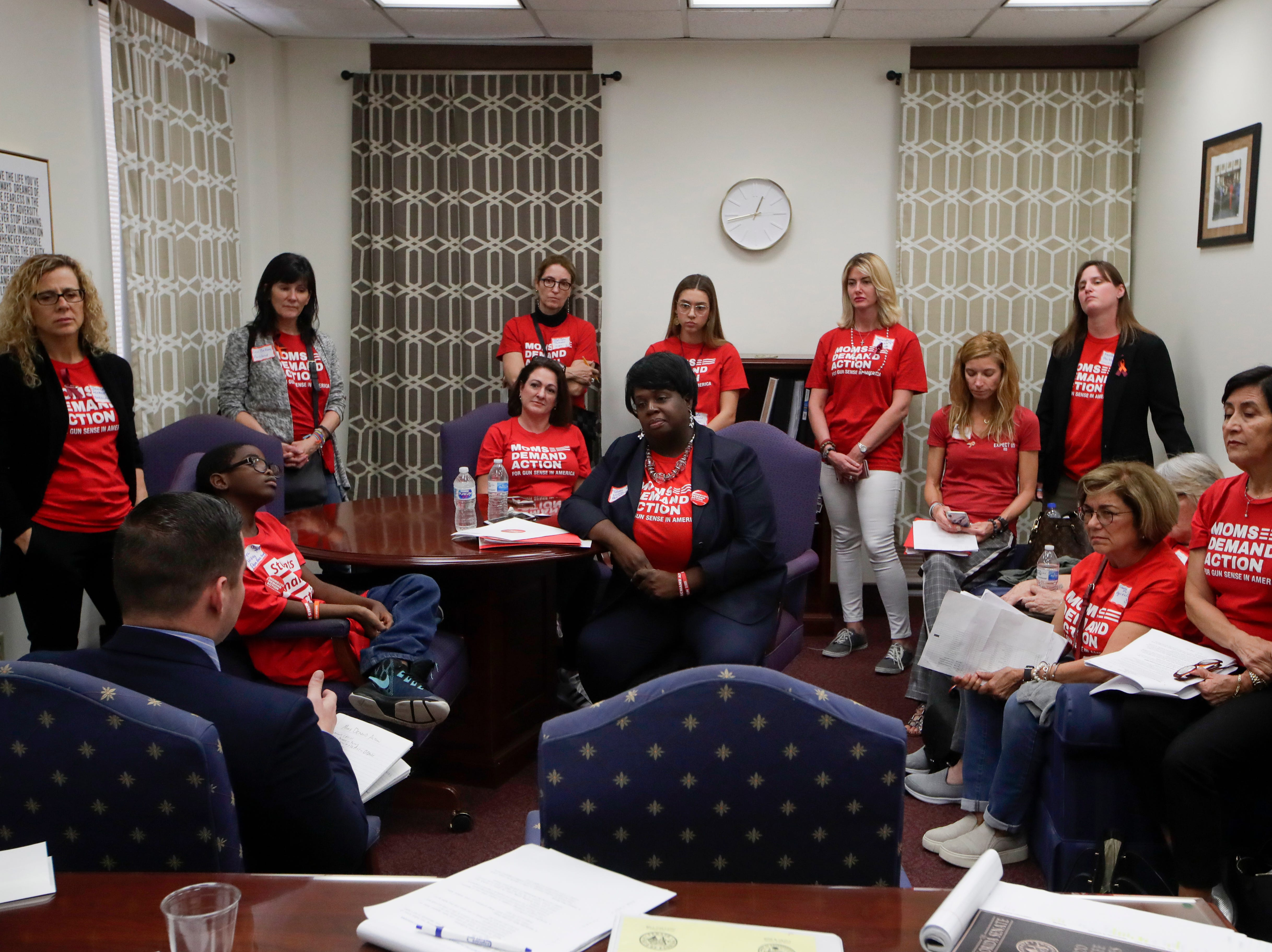 Members of Moms Demand Actions from Broward and Palm Beach counties meet with Tomas Alcala, a legislative assistant to Sen. Bobby Powell to lobby for stricter gun laws in Florida Wednesday, Feb. 6, 2019.