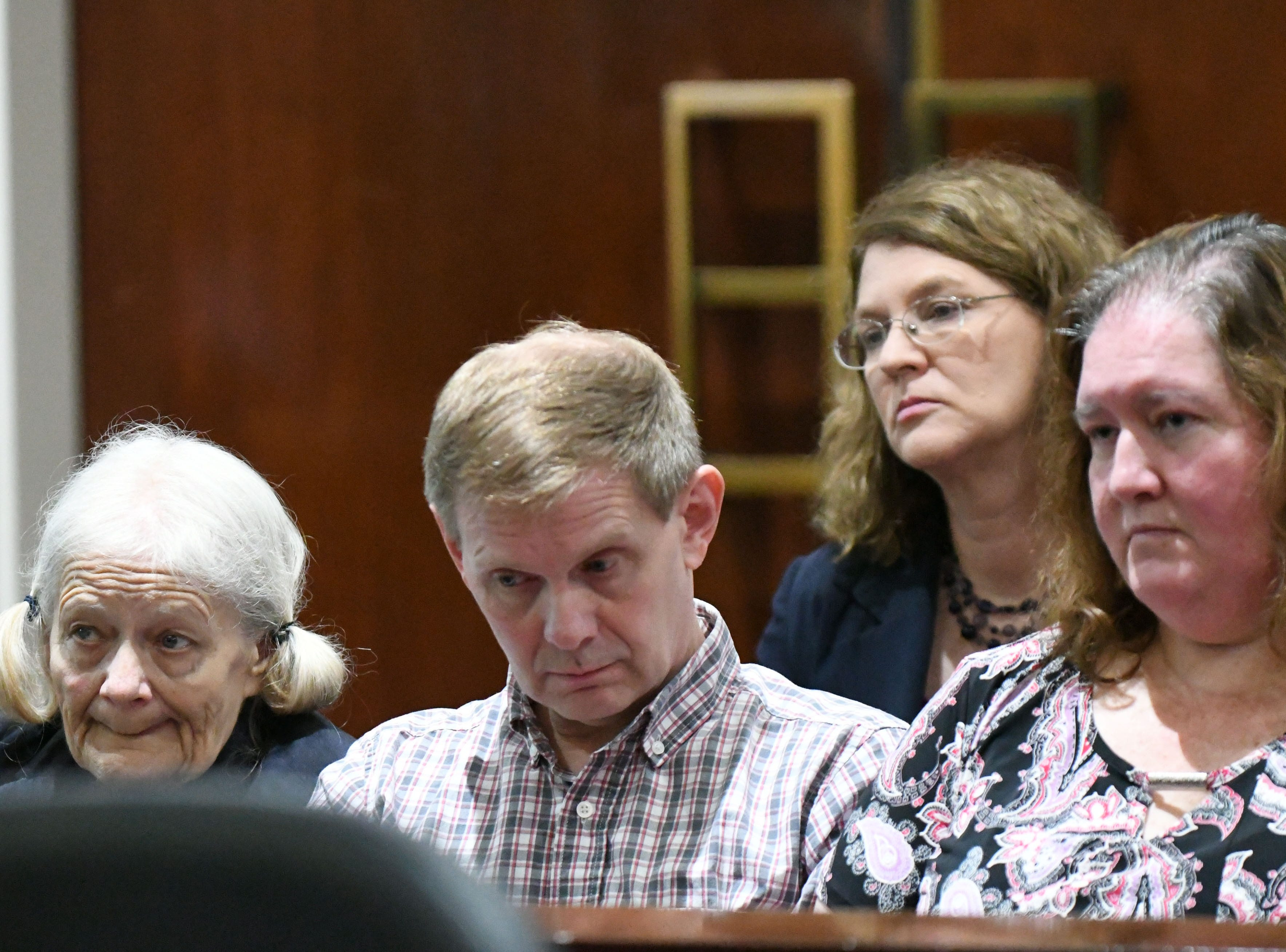 As Judge James C. Hankinson tells Denise Williams her sentencing for the murder of her husband Mike Williams, Cheryl Williams, mother of Mike Williams, the man who was murdered by his best friend and wife, left,  her son Nick Williams, and Jeanne Williams, Nick's wife, listen for the final decision, Wednesday Feb. 6, 2019. Denise was sentenced to life in prison plus 30 years.