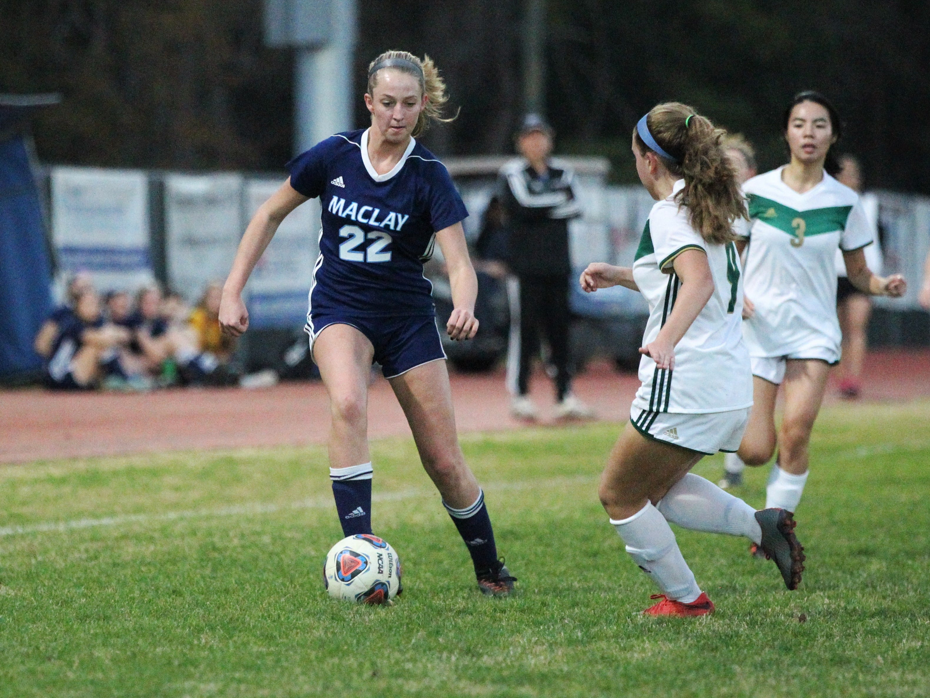 Maclay's Edy Rash tries to take on a defender one-on-one as Maclay's girls soccer team beat St. Joseph Academy 4-0 in a Region 1-1A quarterfinal on Jan. 5, 2019.