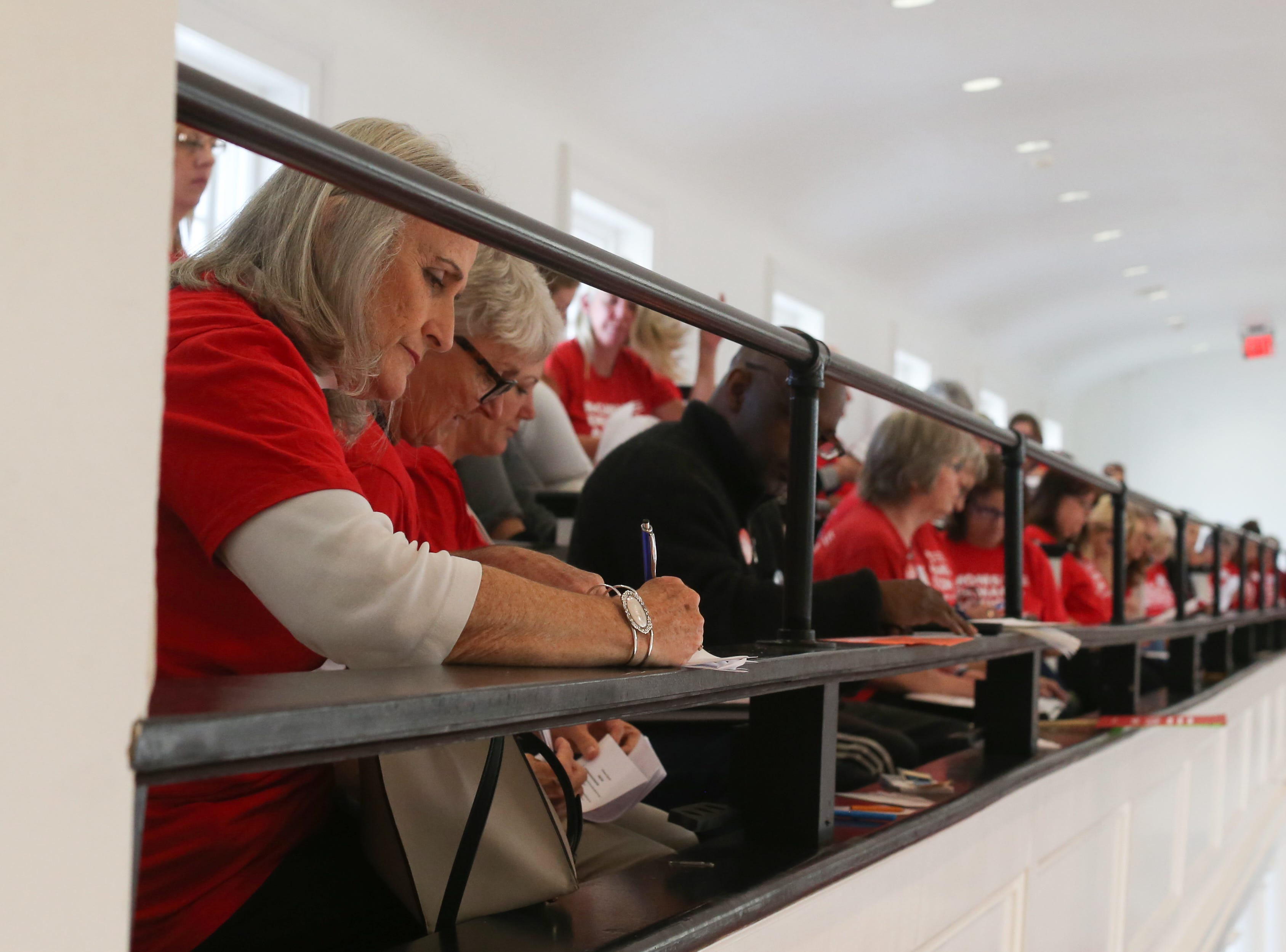 Lynn Janasiewicz, a Tallahassee member of Moms Demand Action, takes notes as leaders go over guidelines for over 500 members of Moms Demand Action to meet with lawmakers at the Capitol Wednesday, Feb. 6, 2019.