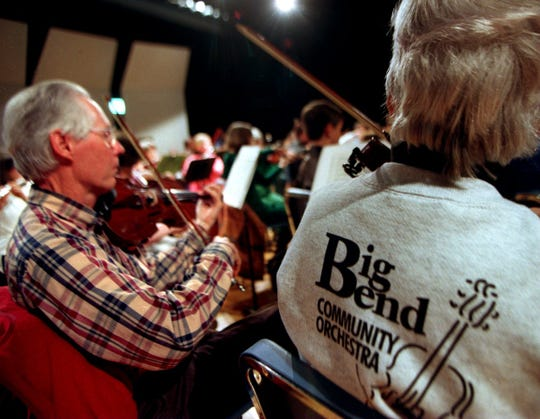 The Big Bend Community Orchestra invites young people to come up on stage after the concert and get to know the musical instruments.