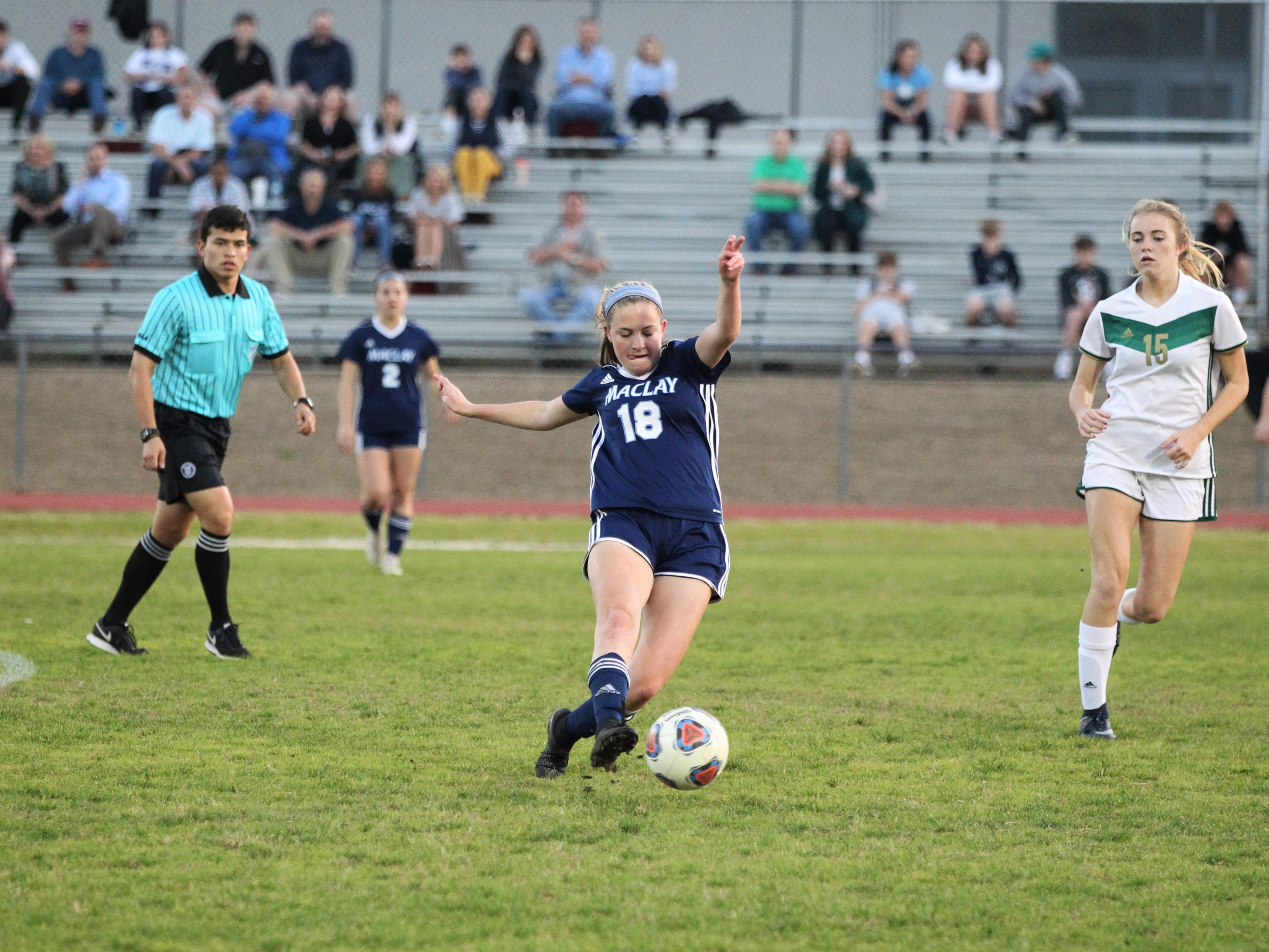 Maclay's Avery Smith passes upfield as Maclay's girls soccer team beat St. Joseph Academy 4-0 in a Region 1-1A quarterfinal on Jan. 5, 2019.