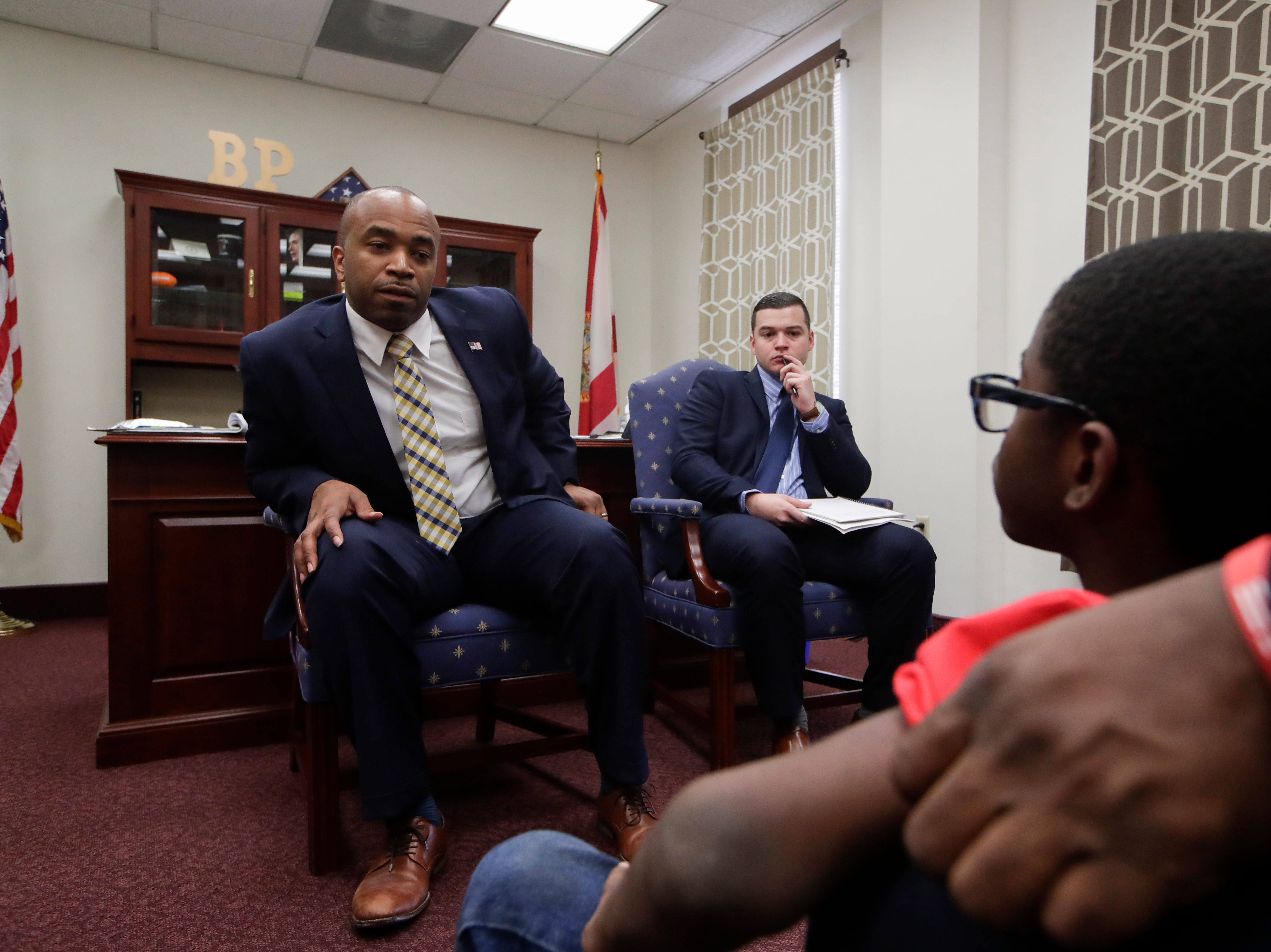 Sen. Bobby Powell talks with Bryce Mckoy, a 9-year-old second grader from Palm Beach County, after Mckoy expressed his fears about going to school after the Marjory Stoneman Douglas shooting last year. His fears prompted his mother, Teisha Mckoy, to join Moms Demand Action and the pair visited the Capitol Wednesday, Feb. 6, 2019 to lobby with over 500 others for stricter gun laws.