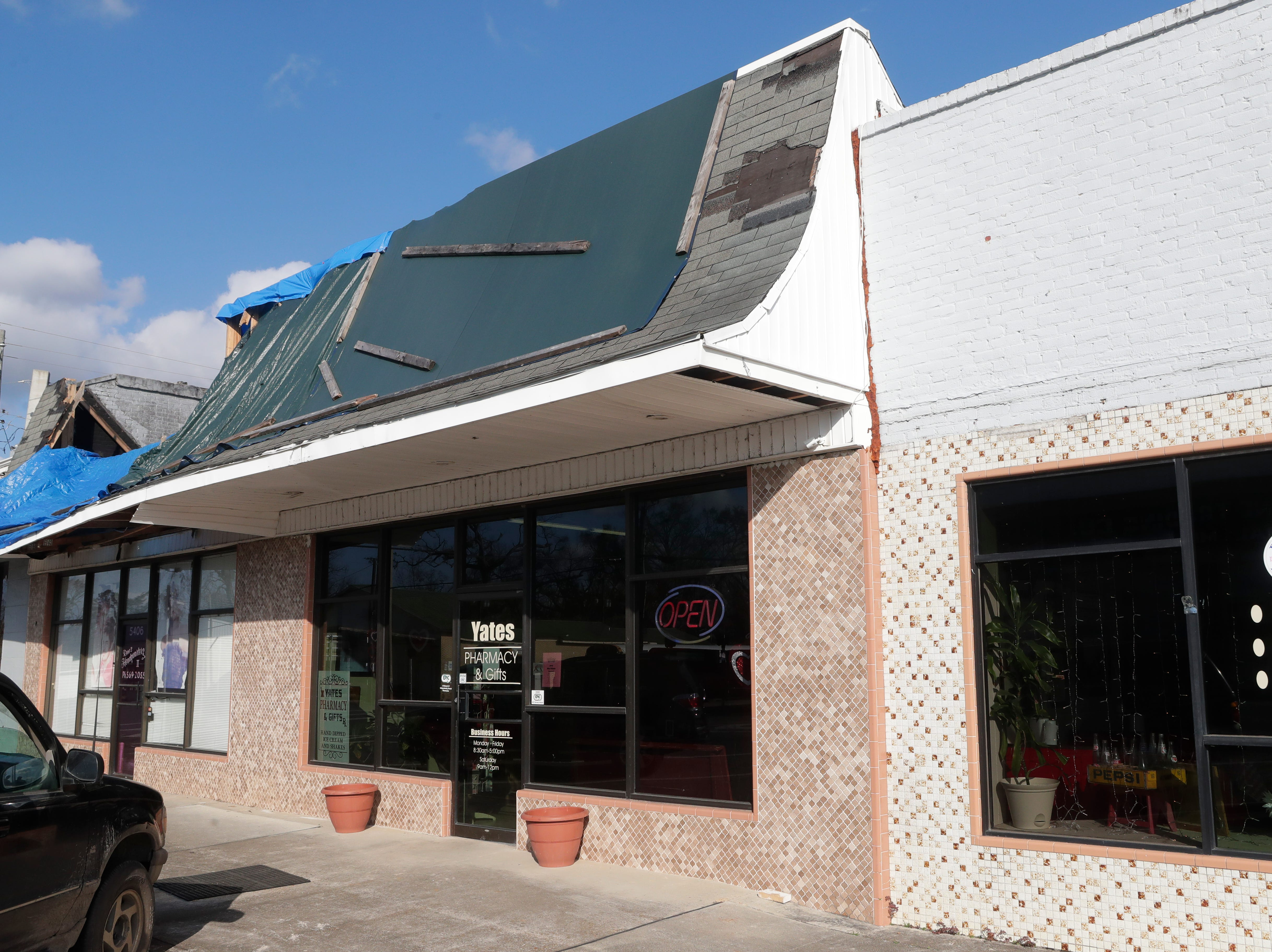 The outside of Yates Pharmacy and Gifts in Malone, Fla., Tuesday Feb. 6, 2019. The roof which was ripped from the building during Hurricane Michael in Oct. 2018 is still in need of repair.