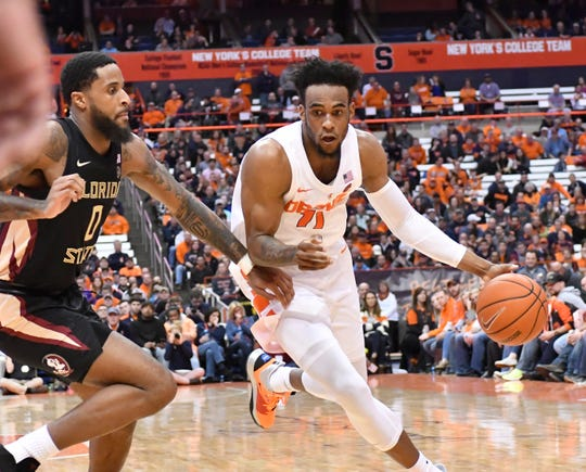Feb 5, 2019; Syracuse, NY, USA; Syracuse Orange forward Oshae Brissett (11) dribbles the ball as Florida State Seminoles forward Phil Cofer (0) defends  in the second half at the Carrier Dome. Mandatory Credit: Mark Konezny-USA TODAY Sports