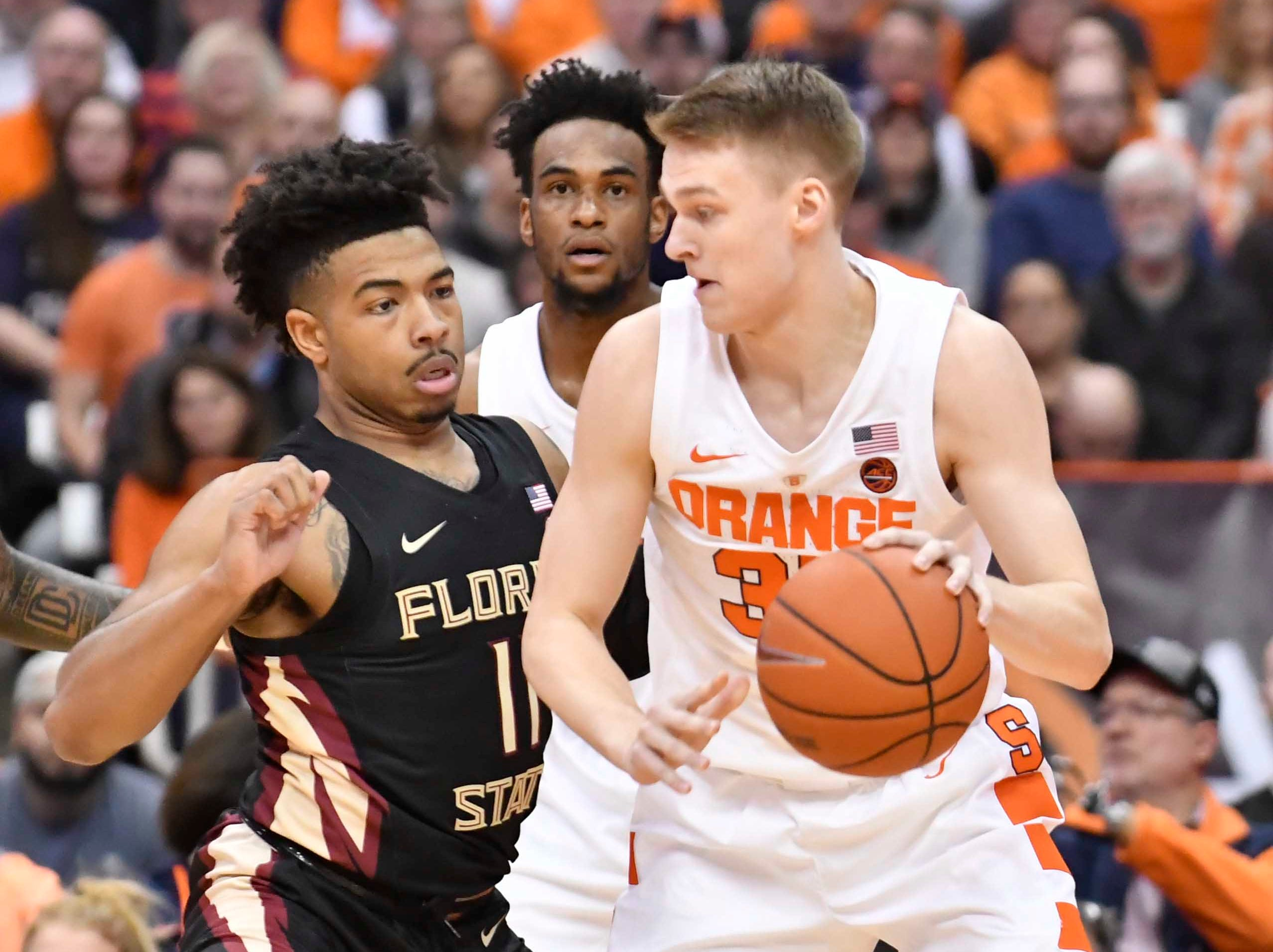 Feb 5, 2019; Syracuse, NY, USA; Syracuse Orange guard Buddy Boeheim (35) works to get the ball past Florida State Seminoles guard David Nichols (11) in the first half at the Carrier Dome. Mandatory Credit: Mark Konezny-USA TODAY Sports