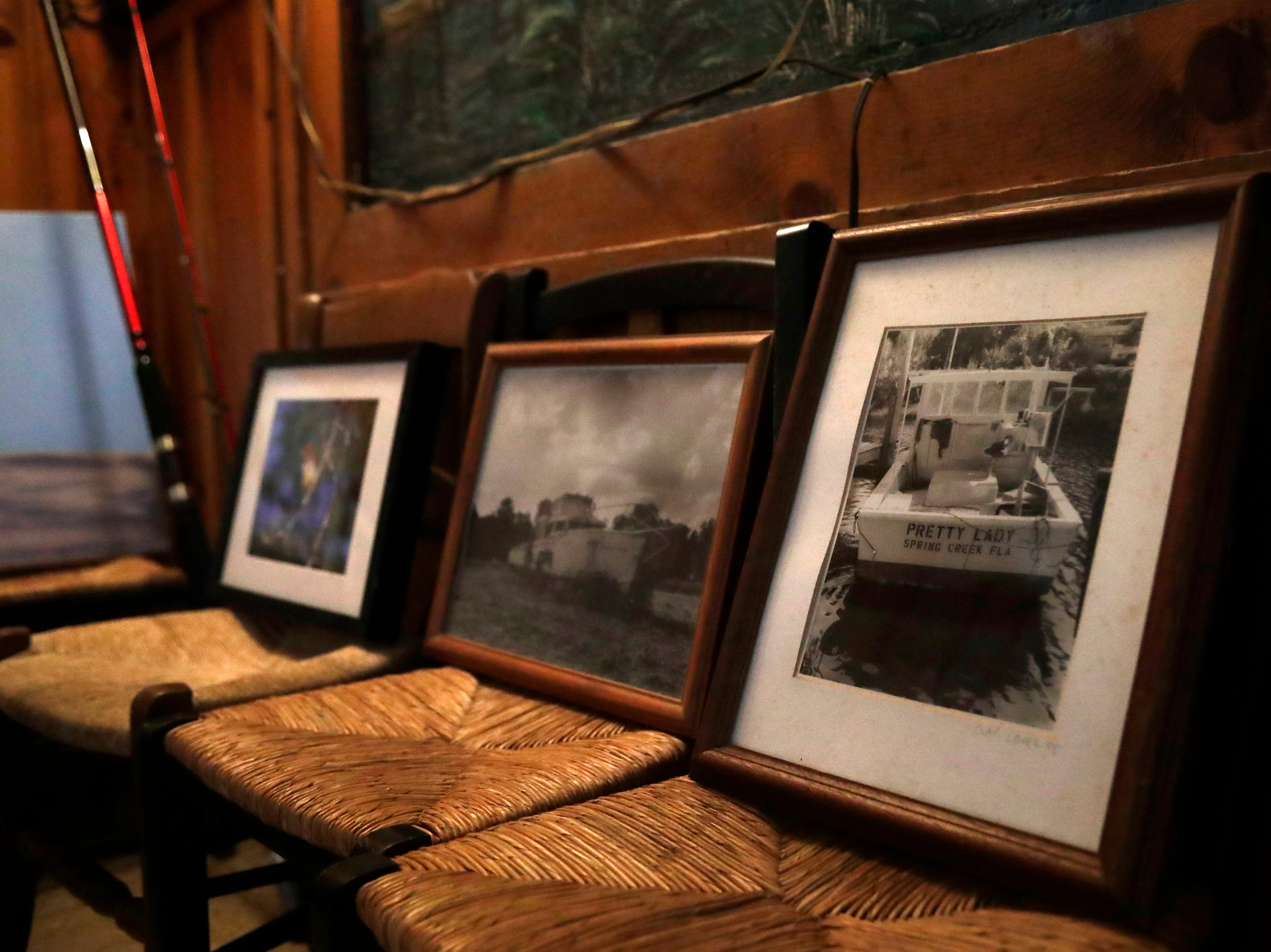 Framed pieces of artwork were able to be salvaged from the wreckage caused by Hurricane Michael. Tuesday, Feb. 5, 2019, the artwork sits on chairs that line the walls in the dining area of the Spring Creek Restaurant.