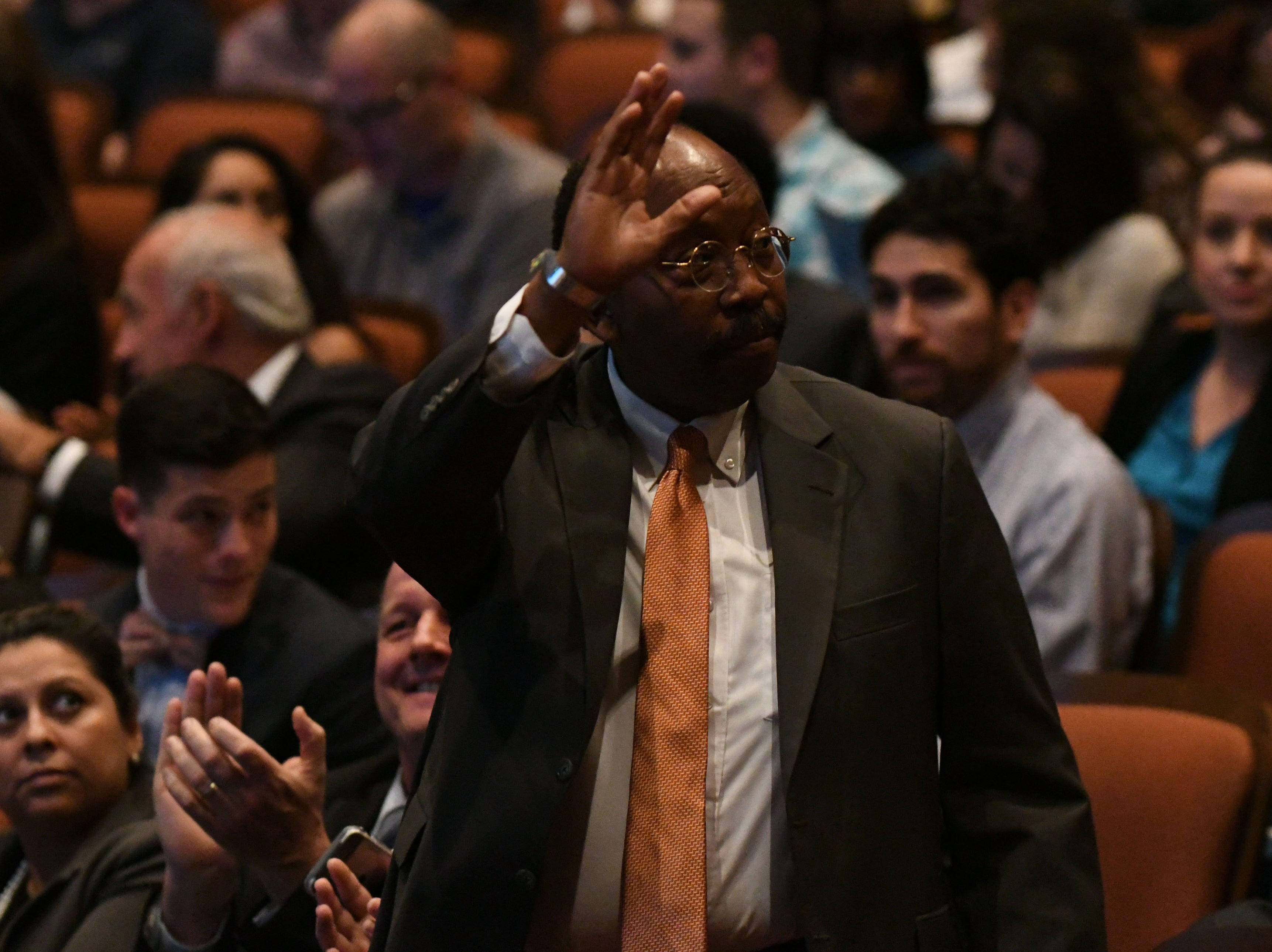 Commissioner Curtis Richardson waves as his name is announced at the Power Forward business event at the Ruby Diamond Hall, Wednesday Feb. 6, 2019. Shark Tank co-star and serial entrepreneur Kevin O'Leary was the featured speaker at the event.