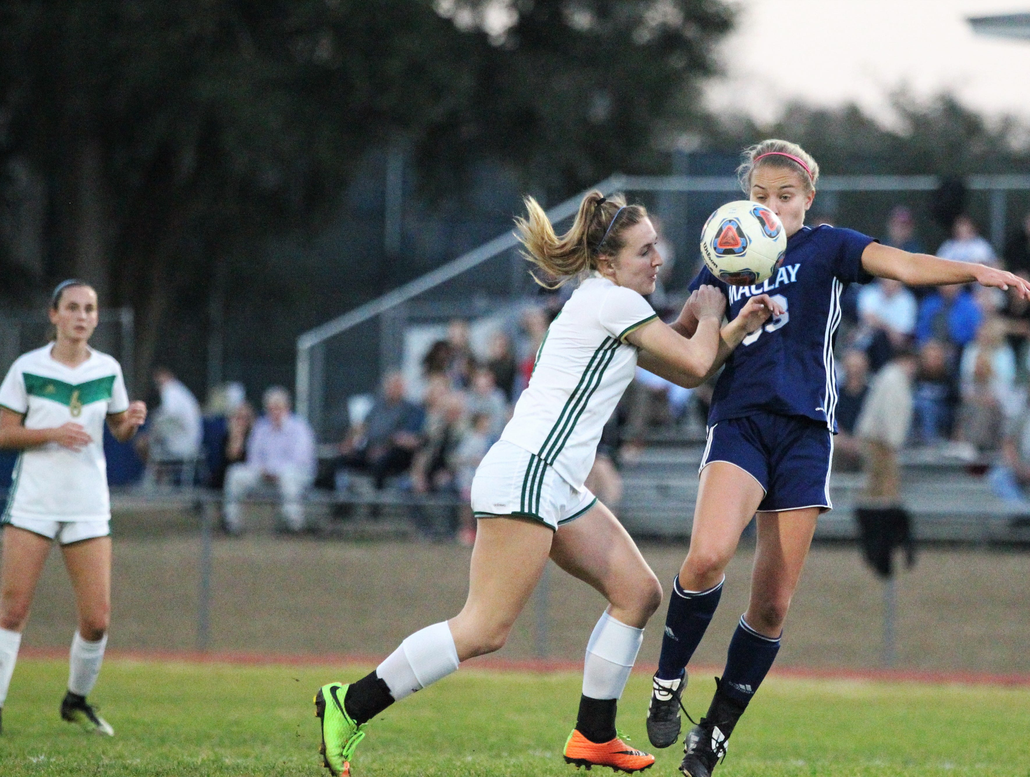 Maclay's Colleen Donahue is fouled while trying to bring down an air ball as Maclay's girls soccer team beat St. Joseph Academy 4-0 in a Region 1-1A quarterfinal on Jan. 5, 2019.