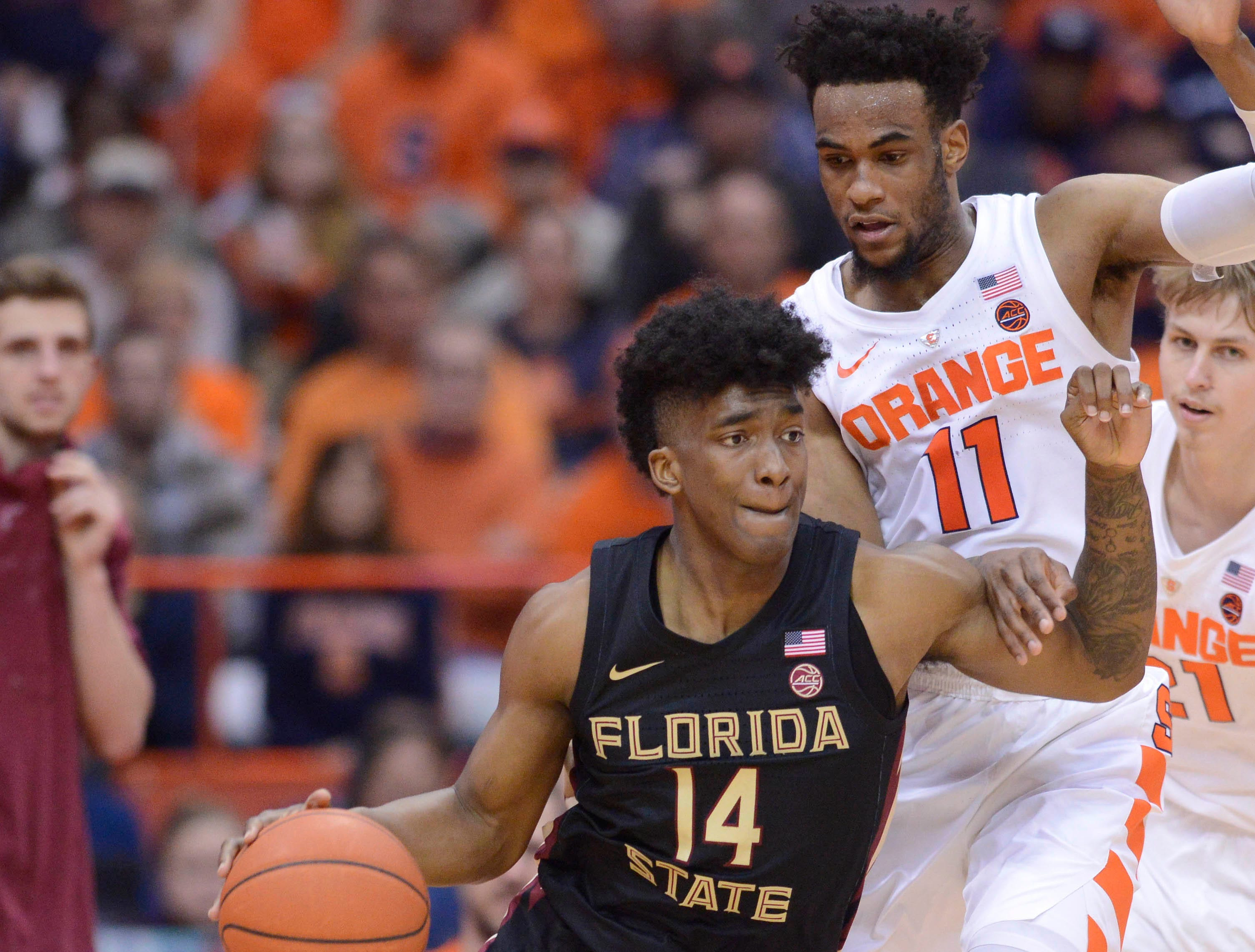 Feb 5, 2019; Syracuse, NY, USA; Florida State Seminoles guard Terance Mann (14) dribbles the ball as Syracuse Orange forward Oshae Brissett (11) defends in the second half at the Carrier Dome. Mandatory Credit: Mark Konezny-USA TODAY Sports