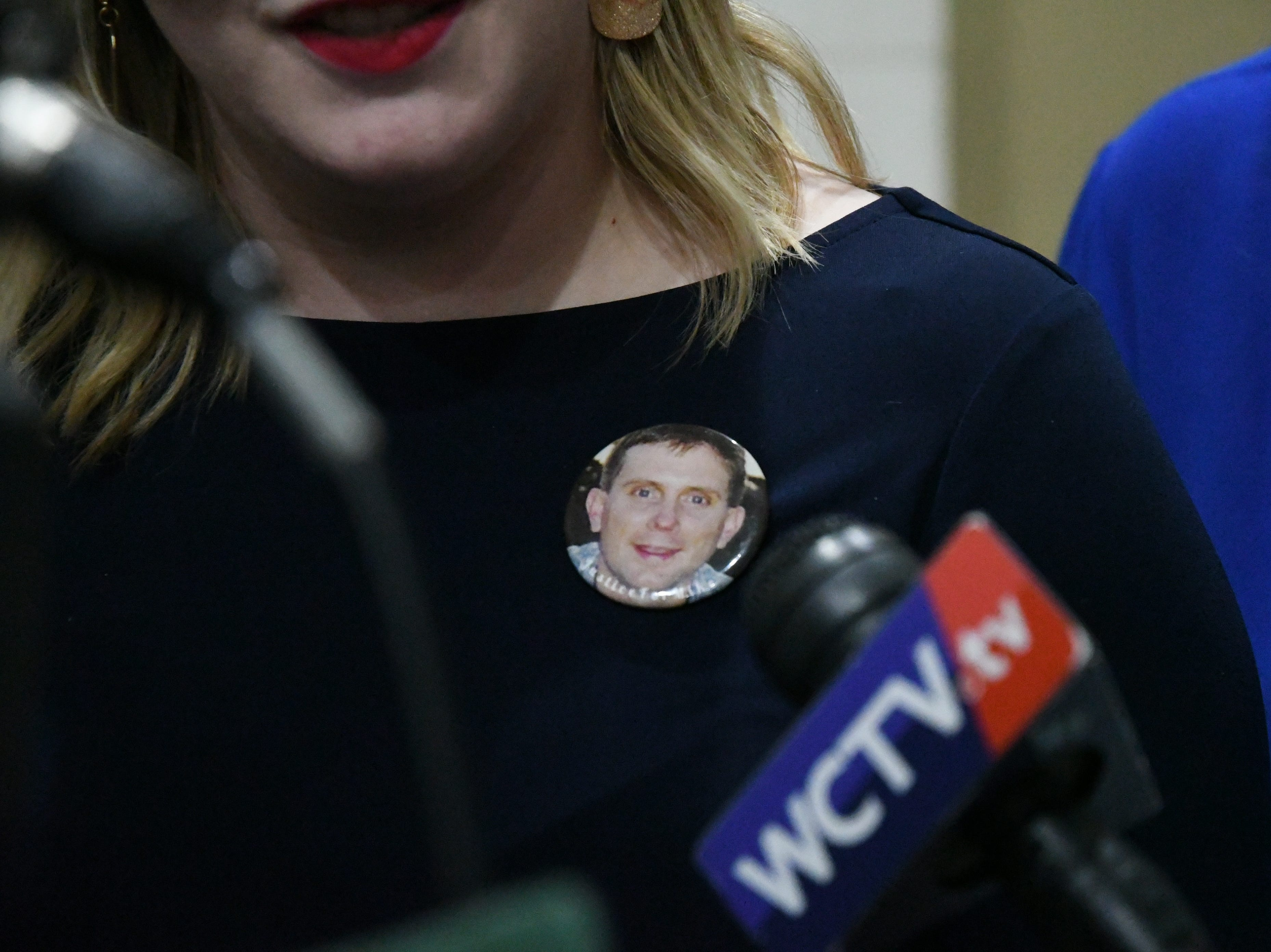 "Marya Denmark, a family friend of the Williams' family, wears a "" Justice for Mike"" buttons she speaks with the media after the sentencing of Denise Williams for the murder of her husband Mike Williams. Williams was sentenced to life in prison plus 30 years, Wednesday Feb. 6, 2019."