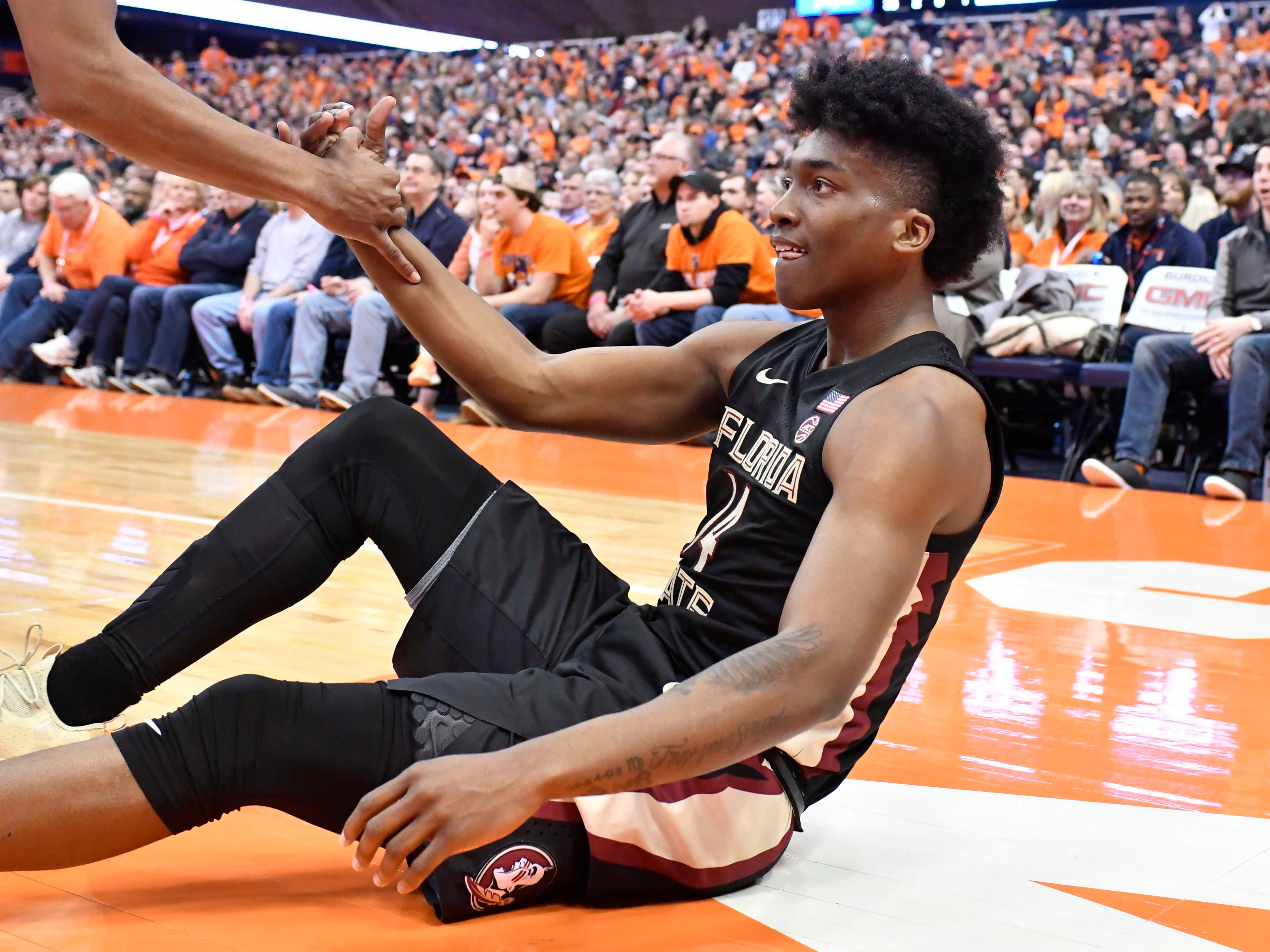 Feb 5, 2019; Syracuse, NY, USA; Florida State Seminoles guard Terance Mann (14) gets up off the floor after being fouled on a shot in the first half against the Syracuse Orange at the Carrier Dome. Mandatory Credit: Mark Konezny-USA TODAY Sports