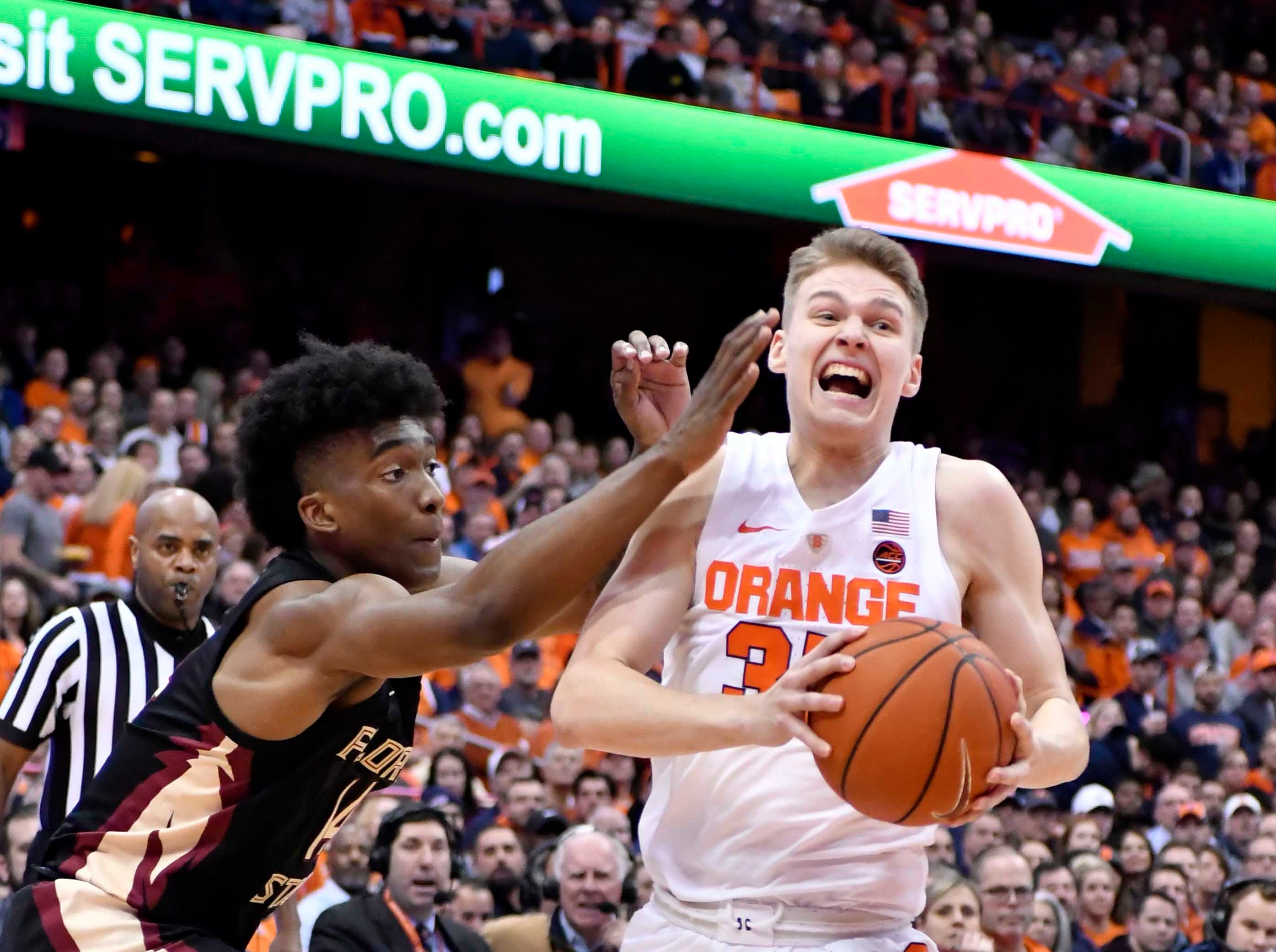 Feb 5, 2019; Syracuse, NY, USA; Syracuse Orange guard Buddy Boeheim (35) takes the ball to the basket as Florida State Seminoles guard Terance Mann (14) defends in the second half at the Carrier Dome. Mandatory Credit: Mark Konezny-USA TODAY Sports
