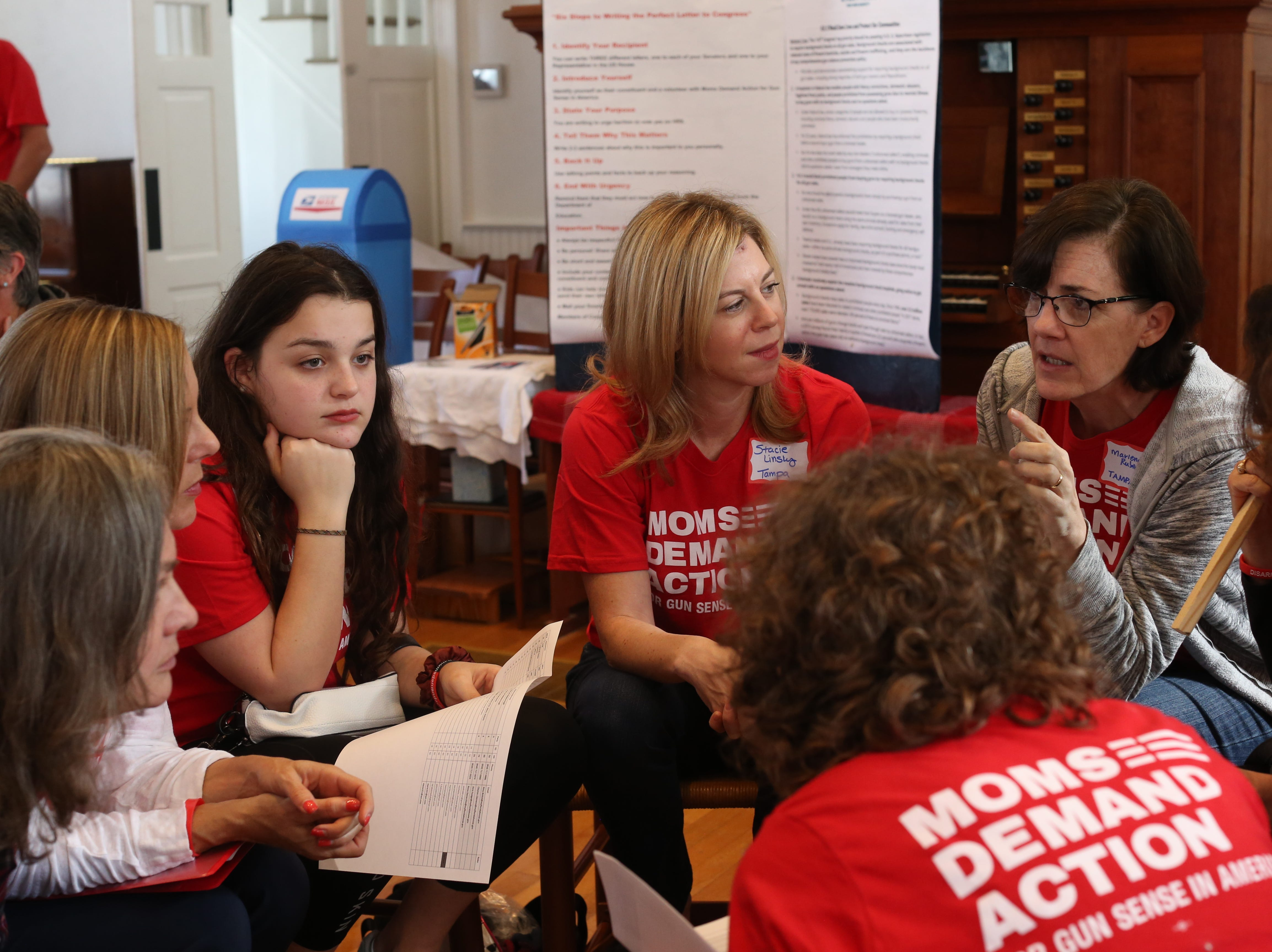 Tampa members of Moms Demand Action huddle up before departing for the Capitol where they would meet with lawmakers to lobby for stricter gun laws in Florida Wednesday, Feb. 6, 2019.