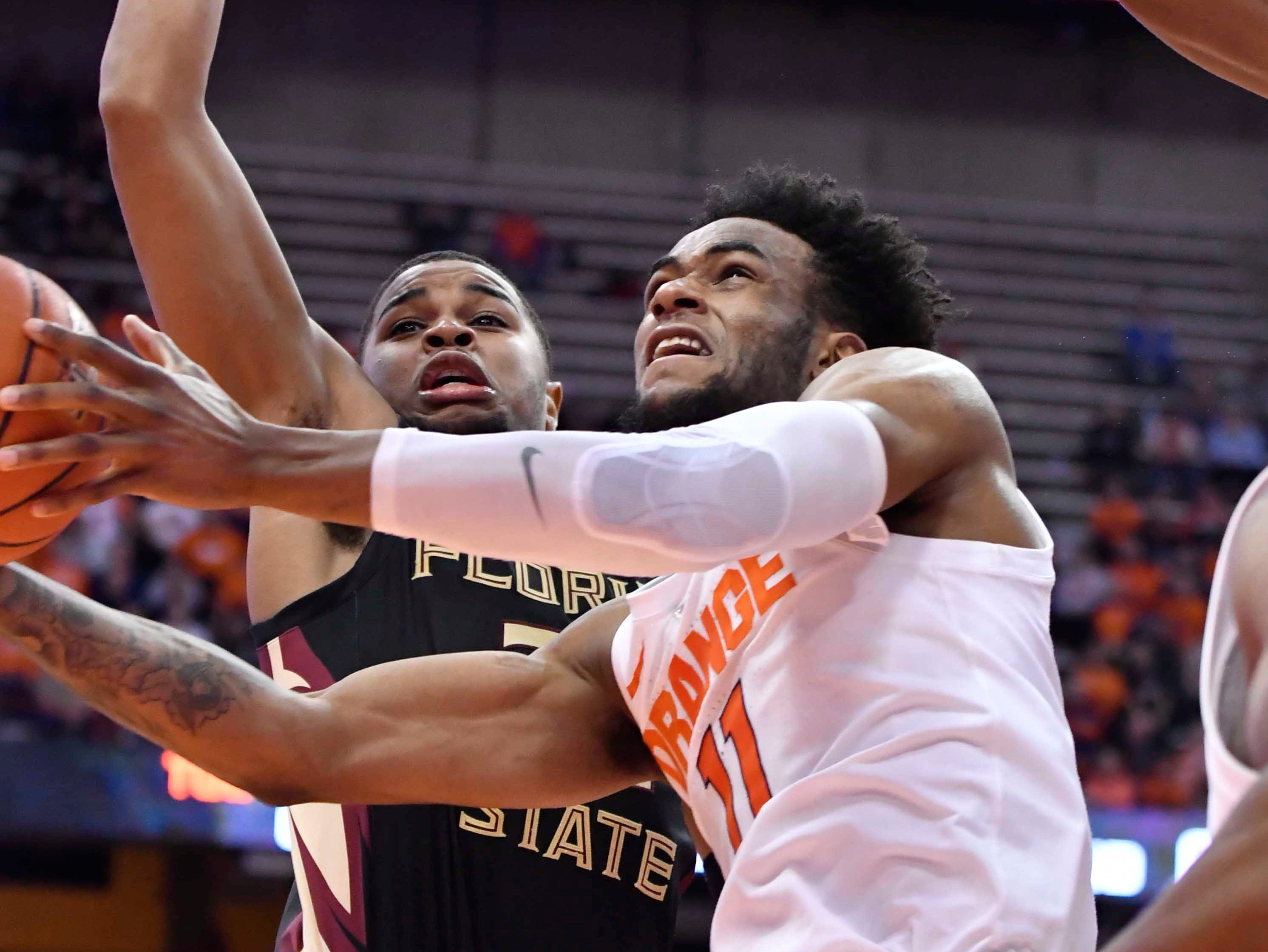 Feb 5, 2019; Syracuse, NY, USA; Syracuse Orange forward Oshae Brissett (11) manuvers to take a shot as Florida State Seminoles guard Trent Forrest (3) applies pressure in the second half at the Carrier Dome. Mandatory Credit: Mark Konezny-USA TODAY Sports