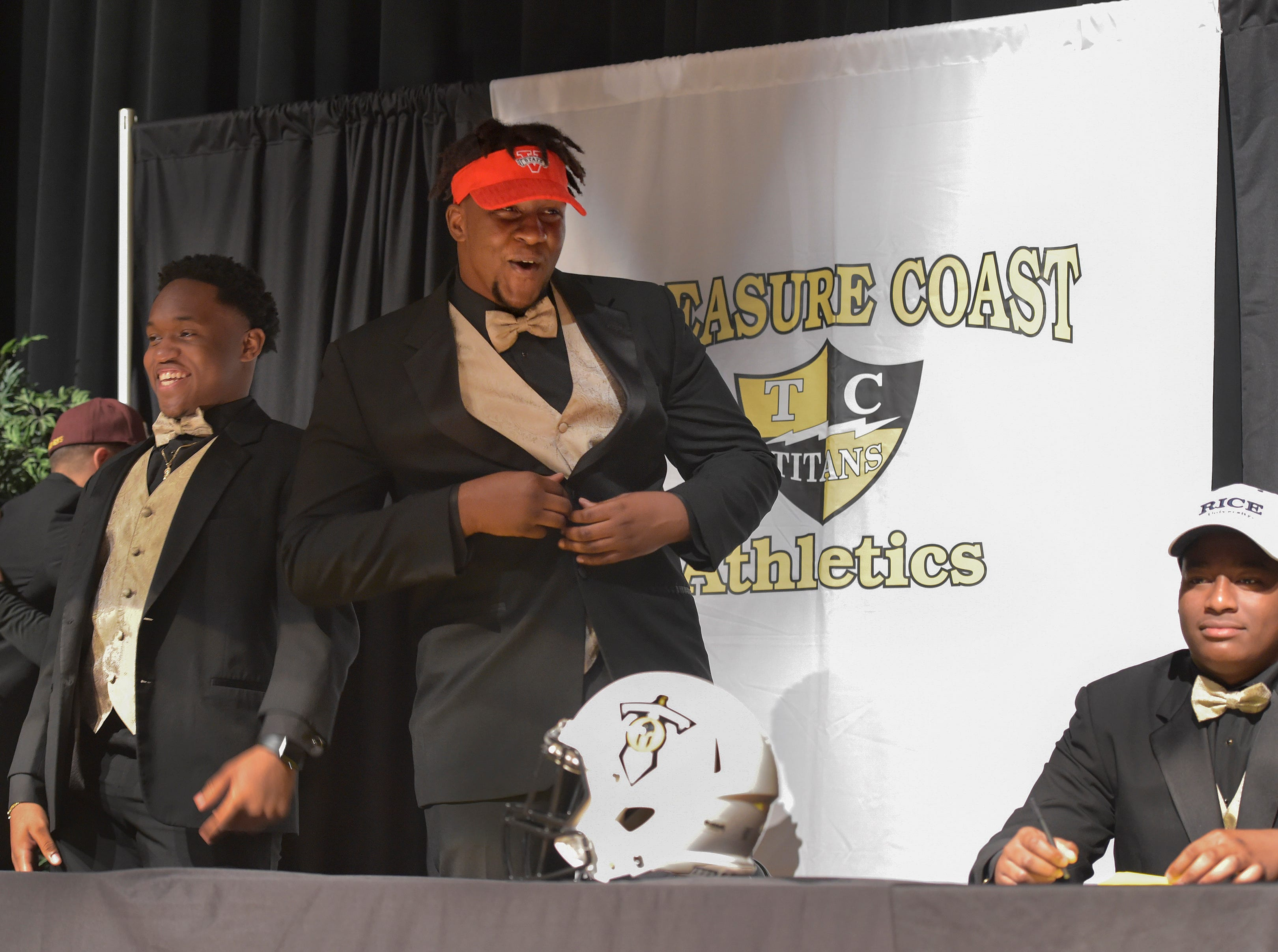"Treasure Coast High School football players (from left) Brendon Joseph, Joel Rose, and Jerry Johnson, begin their celebrations after announcing their college choices during the school's National Signing Day ceremony on Wednesday, Feb. 6, 2019, inside the school's auditorium. ""It's a wonderful experience, I get to share this wonderful experience with my family, coaches , friends, it's a really blessing day,"" said Rose, who signed to play football for Valdosta State."