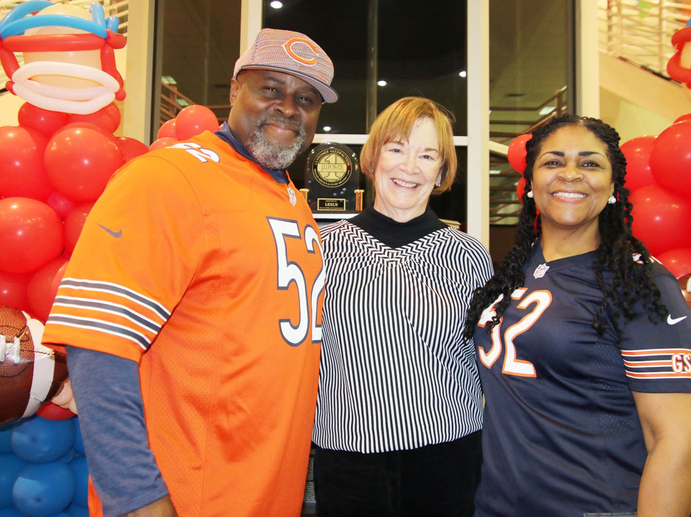 Sandy and Yolanda Mack with Fort Pierce Mayor Linda Hudson, center, at the Voices for Children Ultimate Tailgate Party.