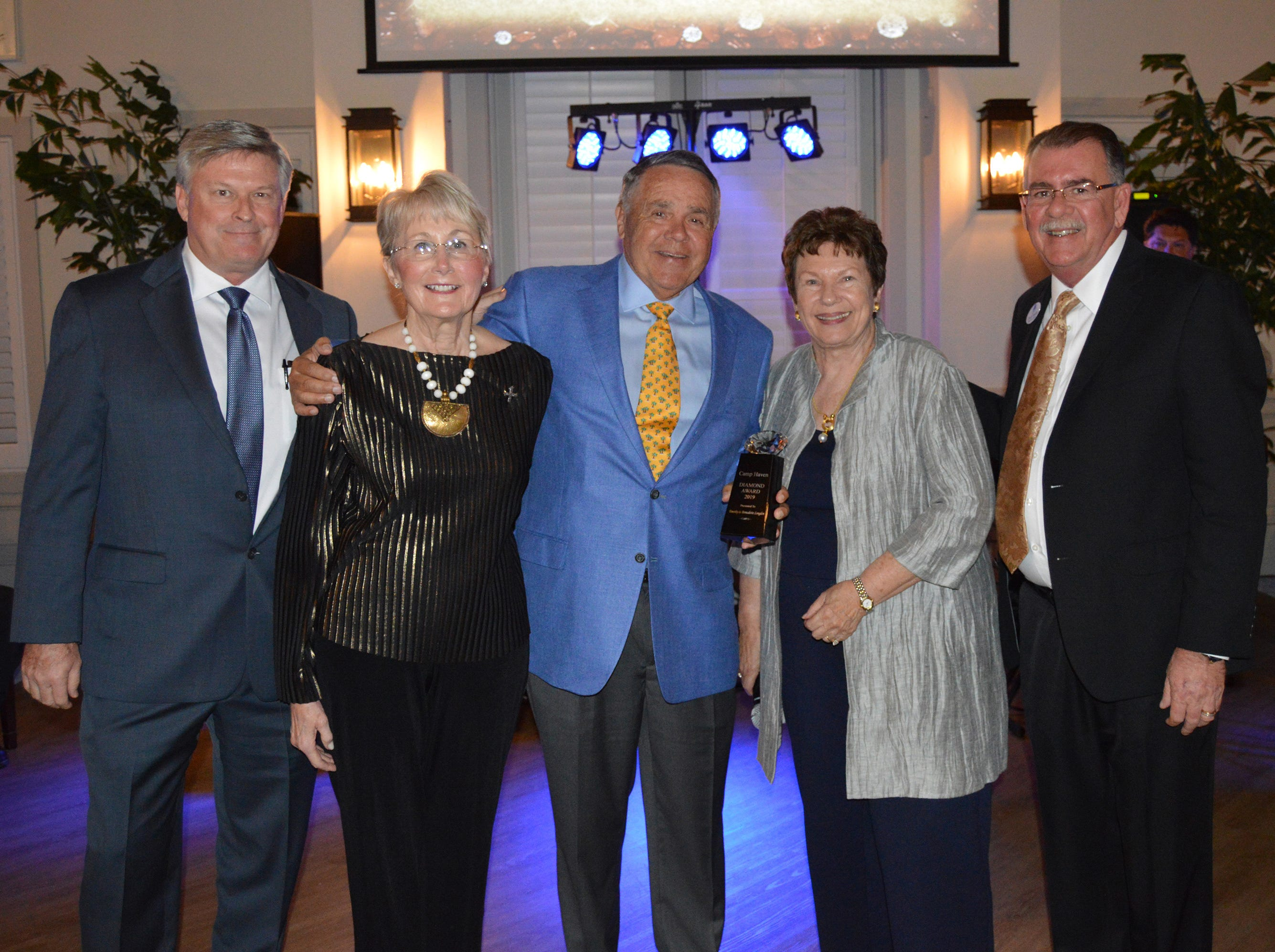 Brian Korkus, left, Bernadette and Tim Longden, Linda Teetz and Chuck Bradley at the Diamonds in the Rough Gala at Grand Harbor Golf & Beach Club on Jan.24.