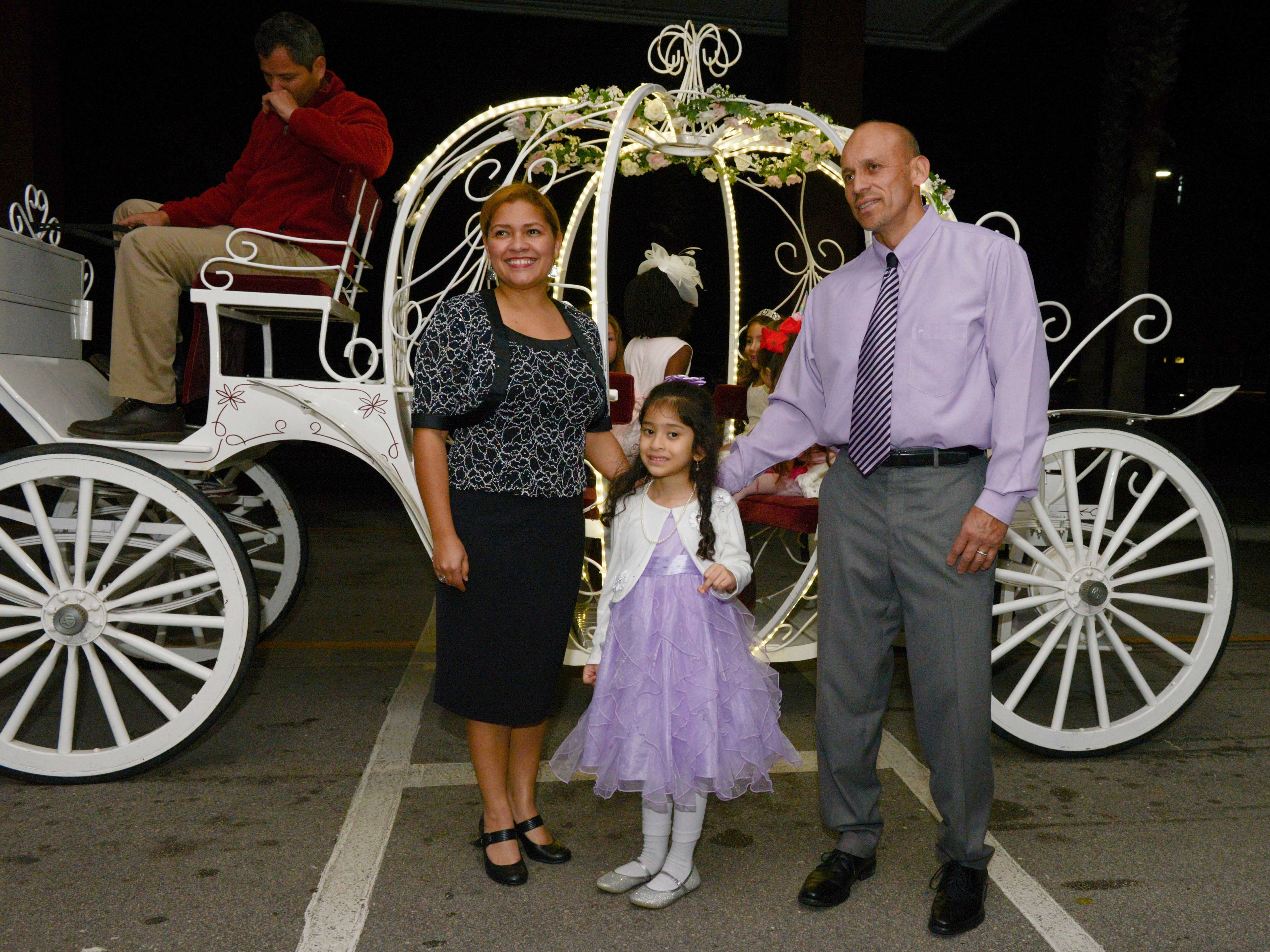 Yelitza, Hannah and Hernando Chaves at the Father/Daughter/Someone Special Dance at Renaissance Charter School of St. Lucie.