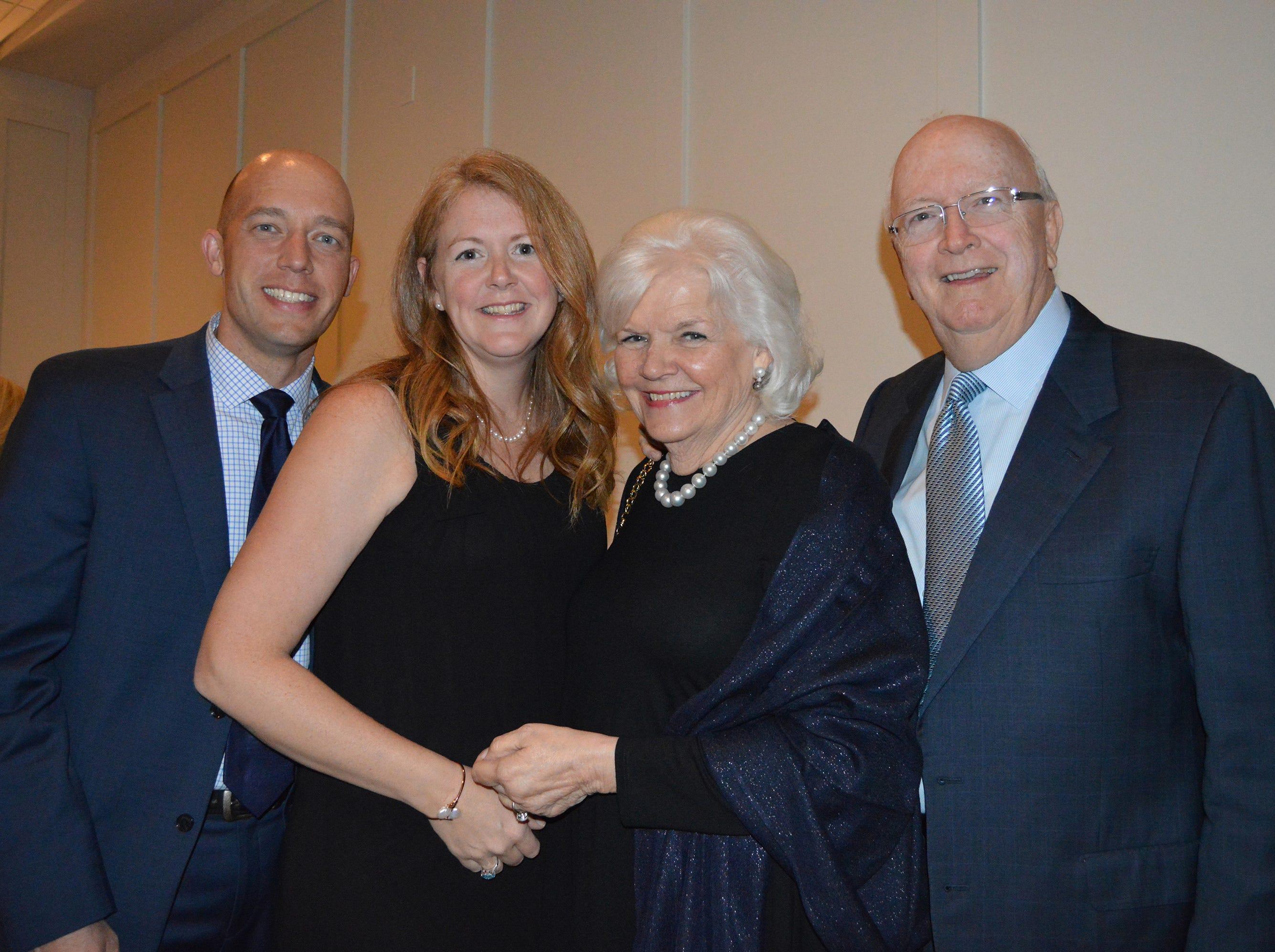 Adam and Sarah Logemann, left, with Linda and Gordon Stewart at the Diamonds in the Rough Gala at Grand Harbor Golf & Beach Club on Jan.24.