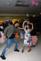 Hector and Jeniras Lopez at the Father/Daughter/Someone Special Dance at  Renaissance Charter School of St. Lucie.