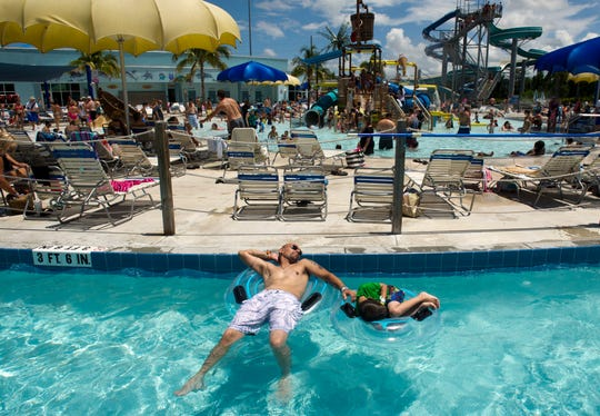 Ben DeVico and his son, Christian, 7, both of Port St. Lucie, relax on the 1000-foot lazy river Sunday at Sailfish Splash Waterpark in Stuart on Sunday, May 31, 2015.