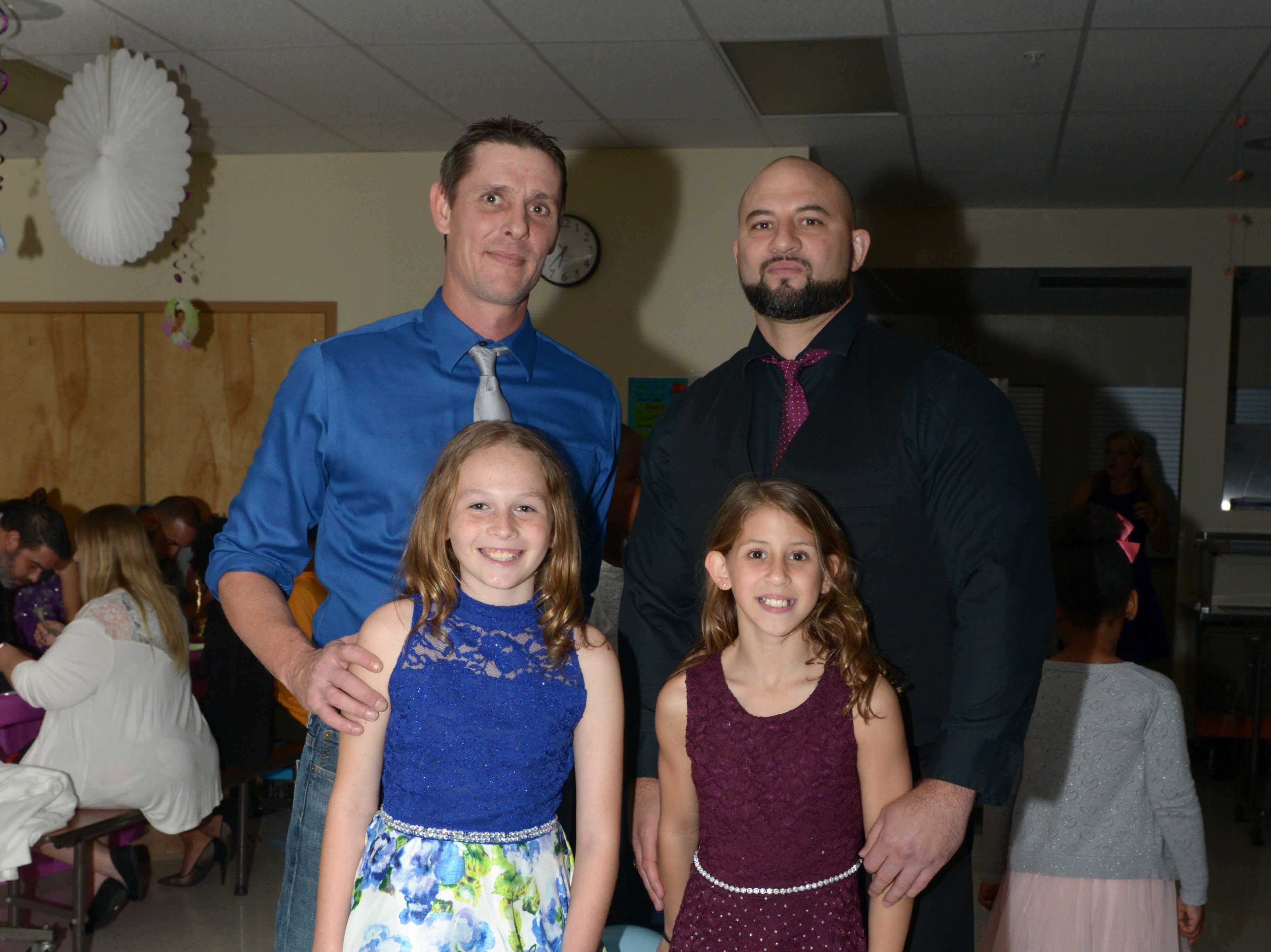 Joshua Lee and Julie Smith with Michael and Izabell Marjieh at the Father/Daughter/Someone Special Dance at Renaissance Charter School of St. Lucie.