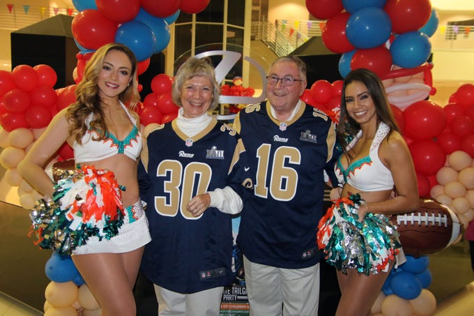 Miami Dolphins cheerleaders with WPSL Radio Station owners Carol and Greg Wyatt at the Voices for Children Ultimate Tailgate Party on Jan. 26 at Treasure Coast Lexus.