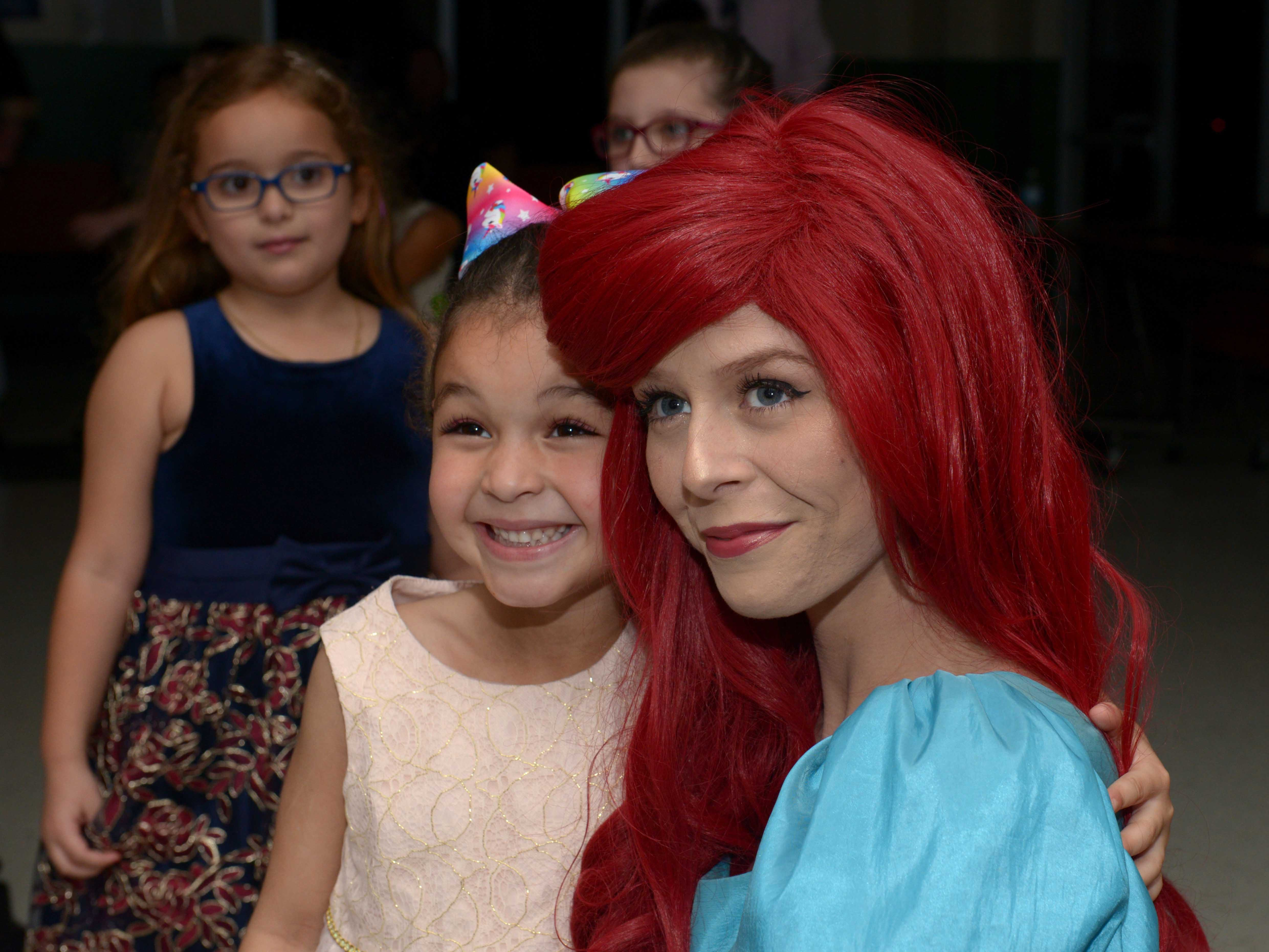 Elionna Johnson with Princess Ariel at the Father/Daughter/Someone Special Dance at Renaissance Charter School of St. Lucie.
