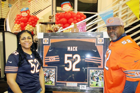 Yolanda and Sandy Mack, parents of NFL player Khalil Mack, at the Voices for Children Ultimate Tailgate Party.
