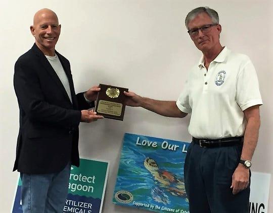 Dr. Duane E. De Freese, left, receives the Environmental Enhancement Award from Tim Glover, president of Friends of St. Sebastian River.