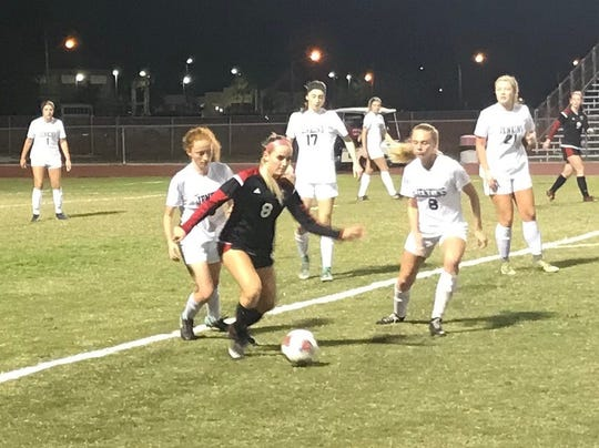 Vero Beach's Kate Hassell dribbles in the first half of the Region 3-5A quarterfinal against George Jenkins on Tuesday night at the Citrus Bowl.