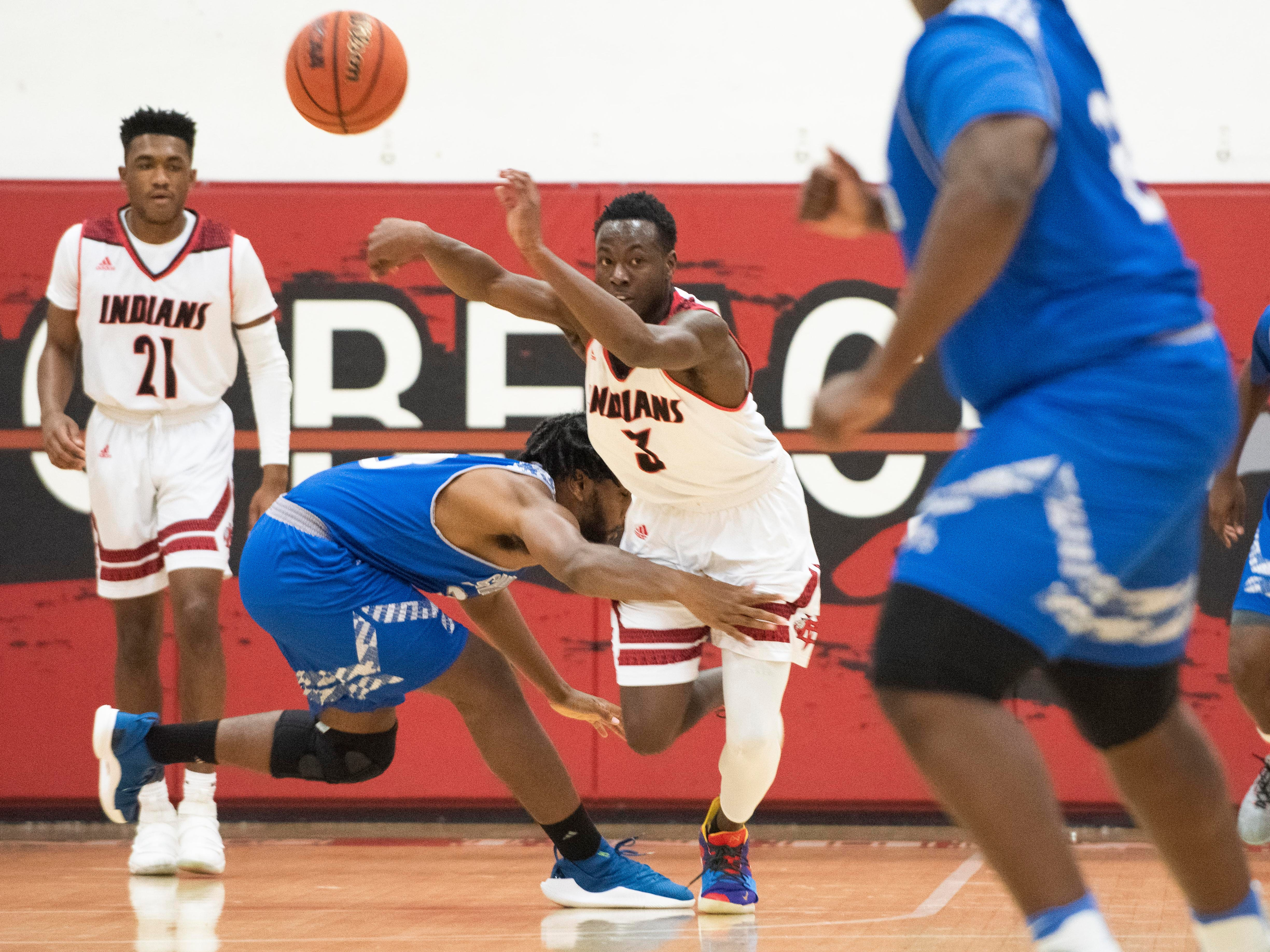 Vero Beach's Tommie Lewis attempts to make a pass after a loose ball during the boys high school basketball game against Sebastian River on Tuesday, Feb. 5, 2019, at Vero Beach High School.