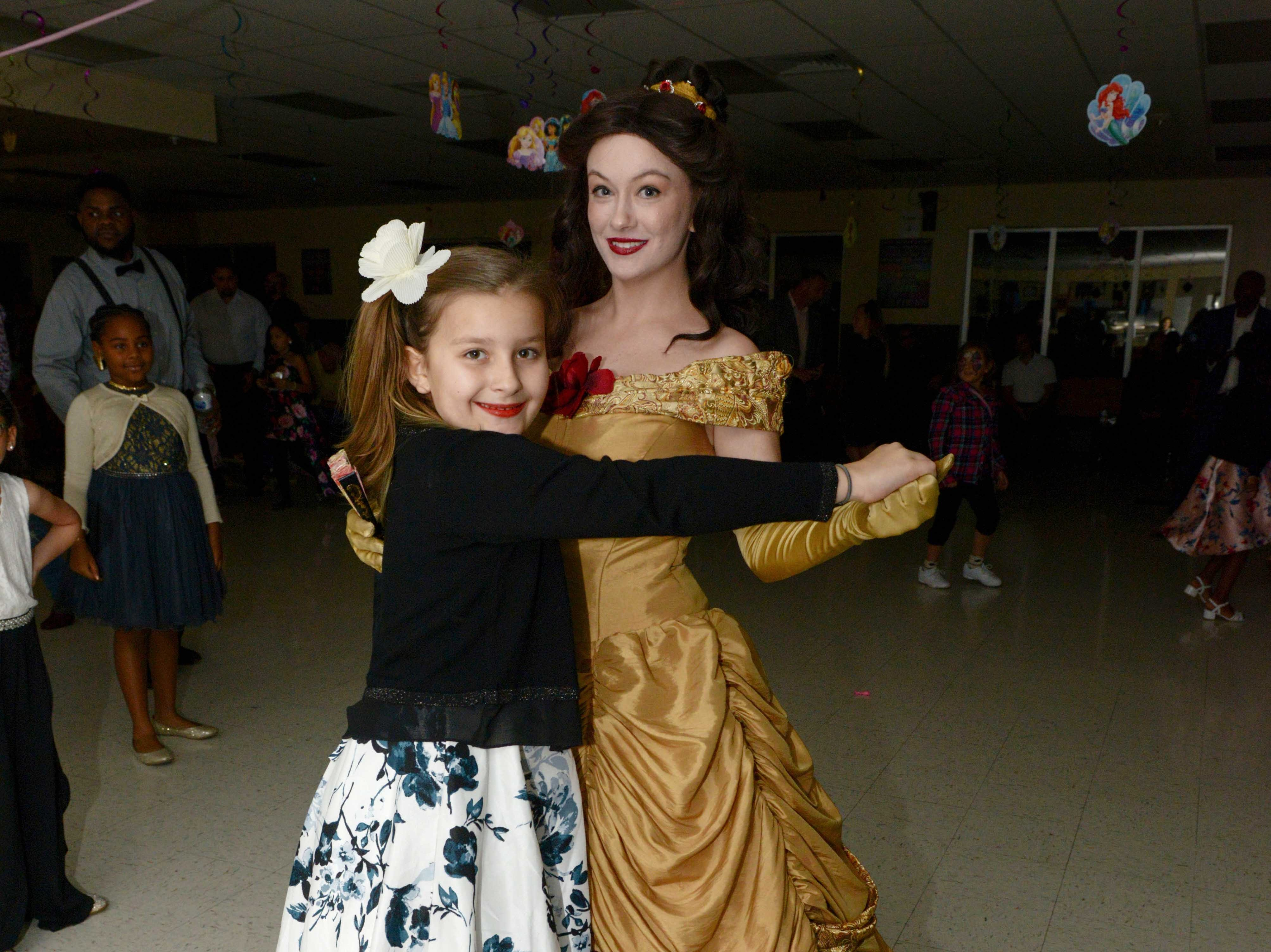 Jada LaCarte dances with Princess Belle at the Father/Daughter/Someone Special Dance at Renaissance Charter School of St. Lucie.
