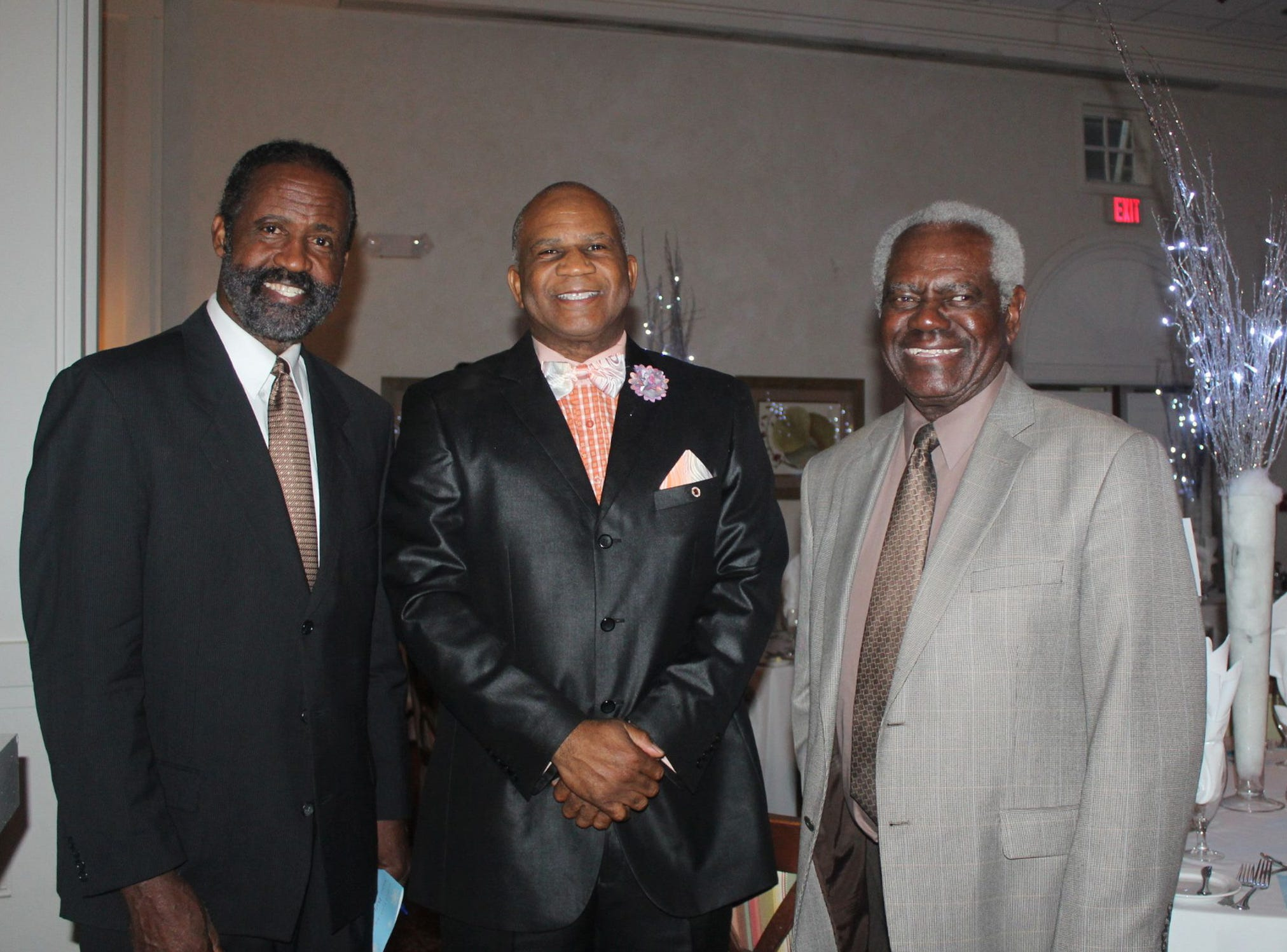 Gifford Youth Achievement Center Director of Public Relations and Facilities Operations Freddie Woolfork, left, Vernon Reason and Dr. Eddie Hudson at the  Snow Ball on Jan. 26.