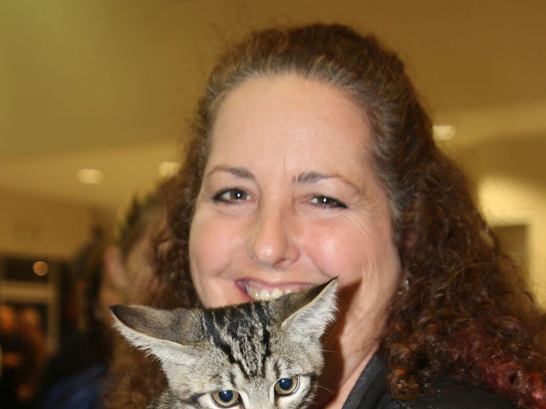 Dr. Suzanne Gambella of Cat Hospital of Vero Beach and Cuddly Kitten at the Voices for Children Ultimate Tailgate Party on Jan. 26 at Treasure Coast Lexus.