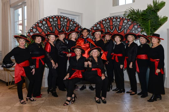 """Taste of Spain & Portugal"" Committee, from left, seated, are co-chairs Mackie Duch and Carole Casey; standing, Sandy Divine, Linda Teetz, Karen Loeffler, Pat Stelz, Julie Otto, ""The Matador"", Diane Wilhelm, Leslie Bergstrom, Gail Prauss, Bonnie Wilson, Elke Fetterolf and Henriette Churney."