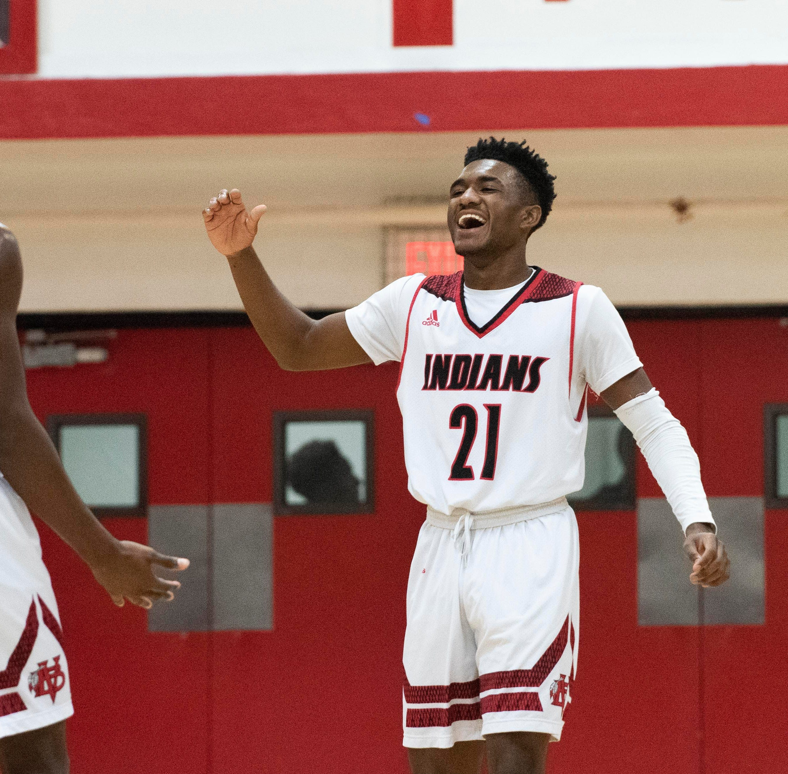 Javian Cuff heats up after halftime to lead Vero Beach boys basketball to district championship