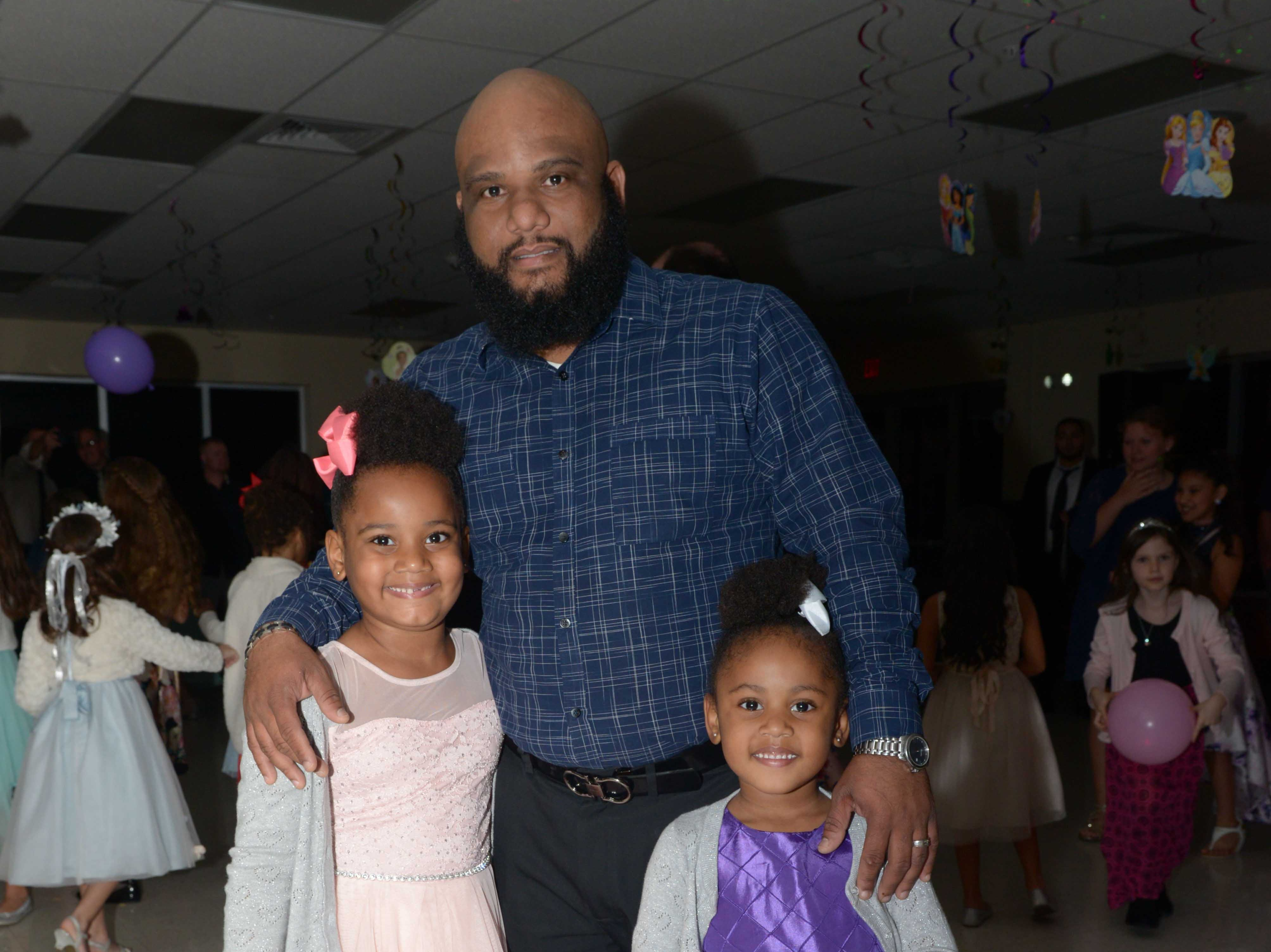 Mircha and Maiah with Fritz Torchon at the Father/Daughter/Someone Special Dance at Renaissance Charter School of St. Lucie.