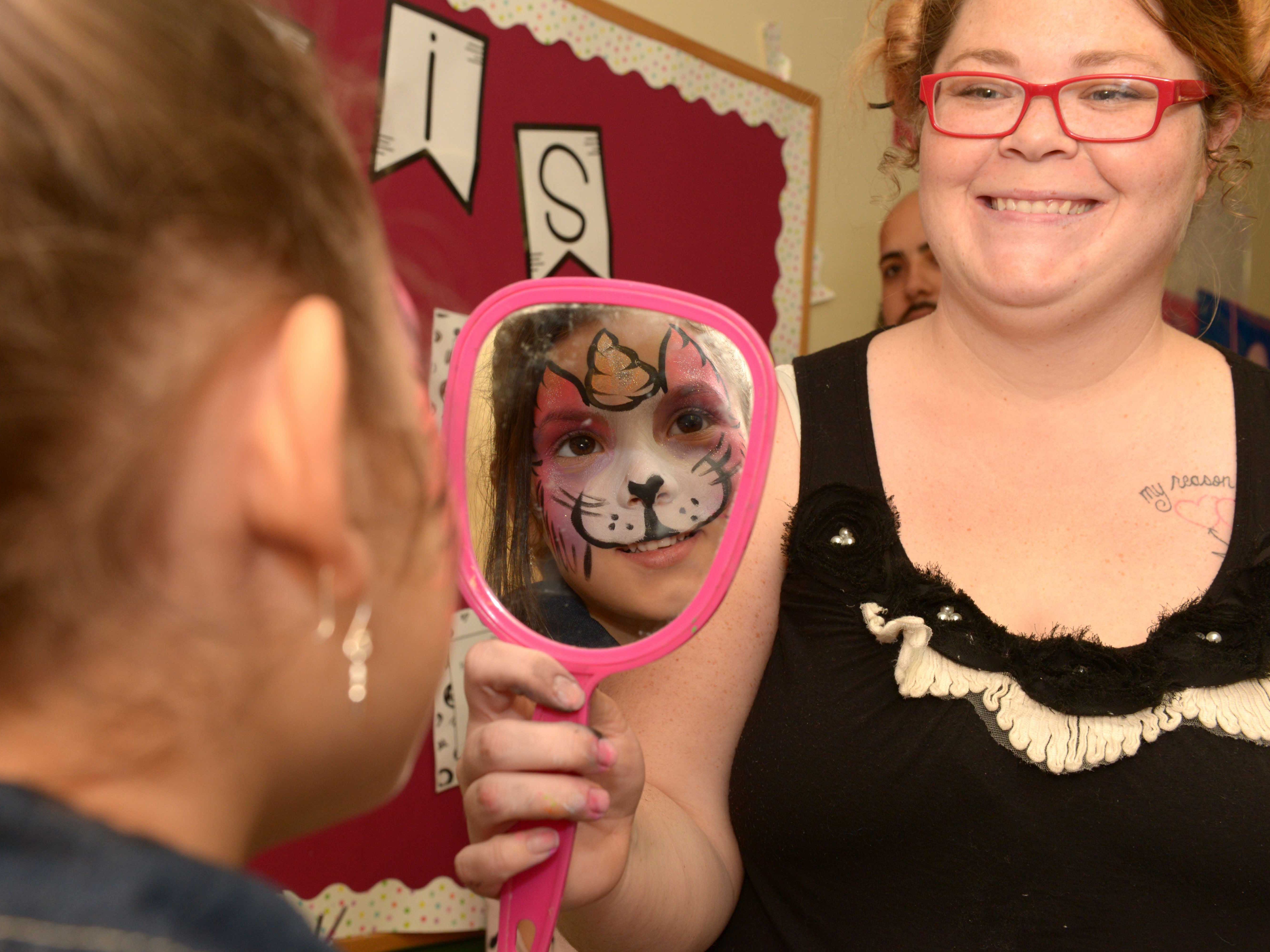 Adaleya with Mollie Hughes of Facepaint by Karla at the Father/Daughter/Someone Special Dance at Renaissance Charter School of St. Lucie.