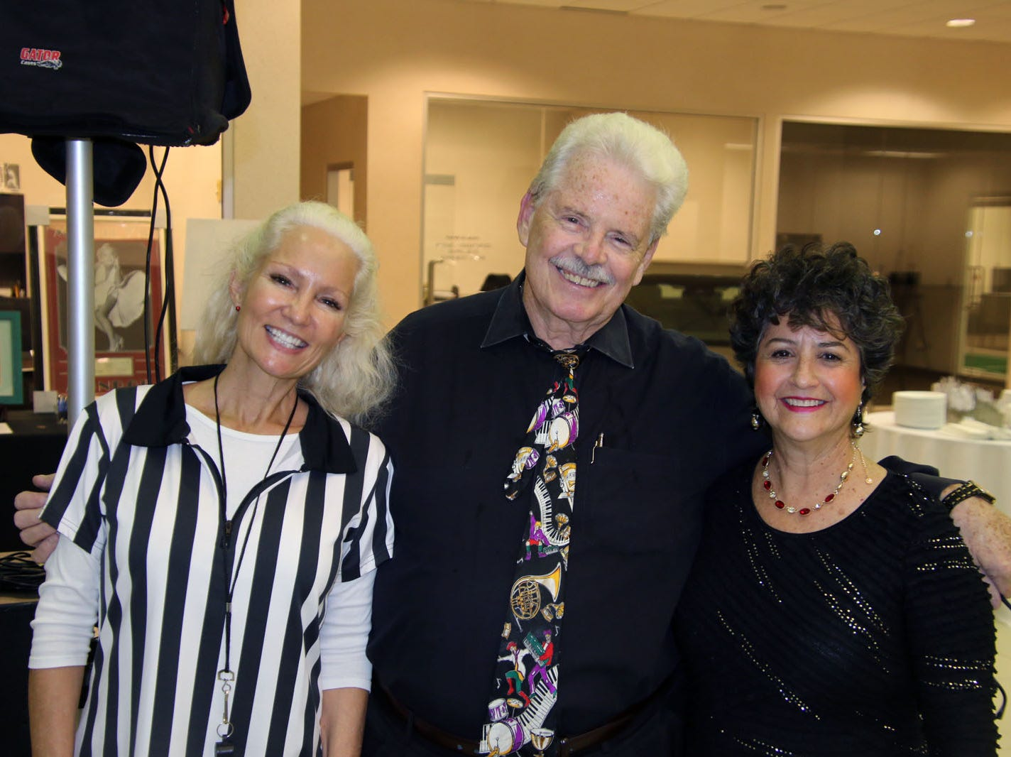 Voices for Children volunteer Kip Lyman, left, with Don and Debbie Bestor of the Sunrise Party Band at the Ultimate Tailgate Party.
