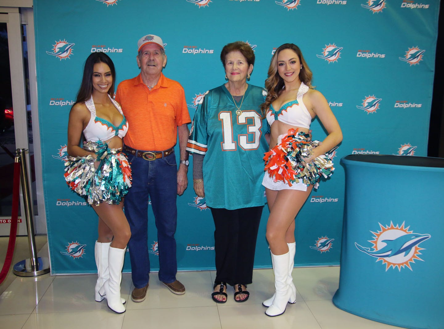 Miami Dolphins cheerleaders with Gene and Jane Rowley at the Voices for Children Ultimate Tailgate Party.