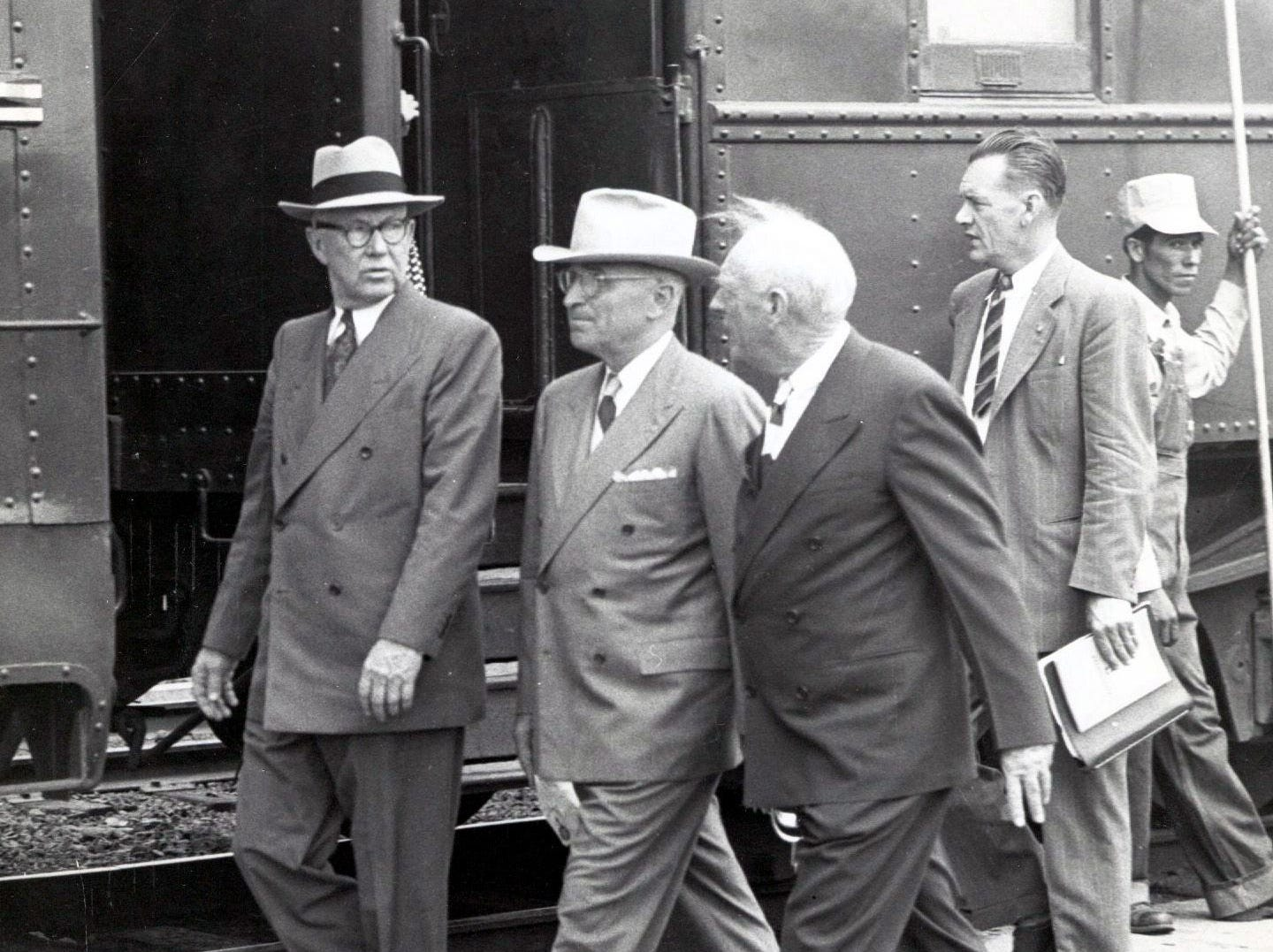 Federal Judge R.E. Thomason, President Harry Truman and Robert L. Holliday stride along briskly as the president prepared to board a train to continue his Texas tour after his El Paso speech on Sept. 25, 1948.