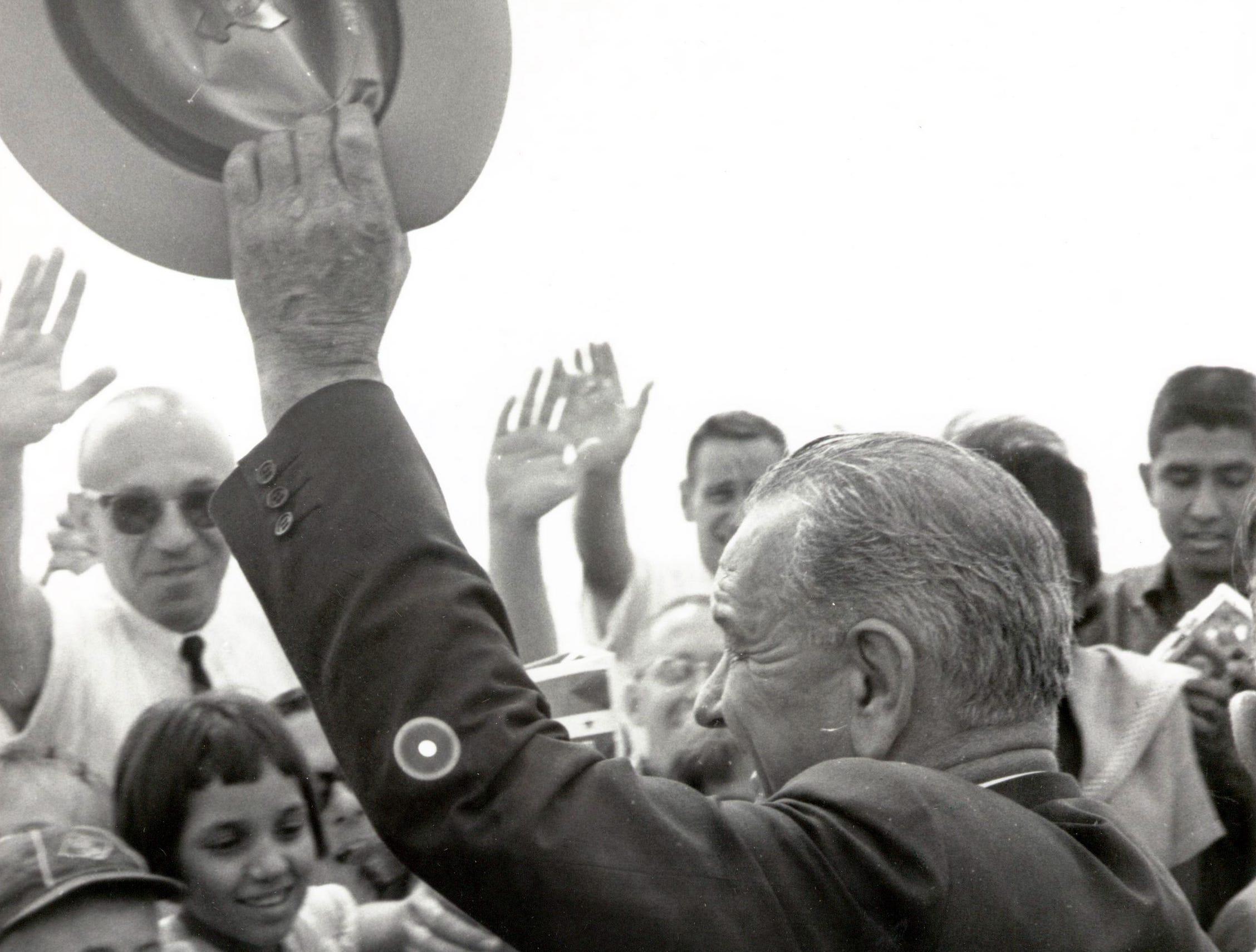 September 25, 1964 - President Lyndon Johnson waves to the crowd.