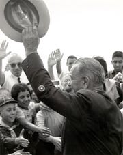 September 25, 1964 - President Lyndon Johnson waves to the crowd.