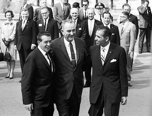Sep. 25, 1964-President Adolfo Lopez Mateos, left, President Lyndon B. Johnson, and Raymond Telles, U.S. ambassador to Costa Rica, right, all join arms at Stanton street Bridge ceremonies commemorating settlement of the Chamizal dispute.