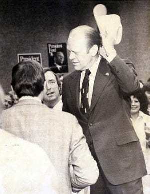 04/11/1976 - SPECIAL PRESENTATION - President Gerald Ford thanks El Paso Myaor Don Henderson Saturday after he was presented a specially designed pair of boots and a western hat. The gifts were presented during Ford's visit with Republican campagin workers in the Civic Center.