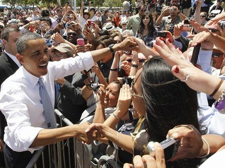 President Barack Obama greets audience members after he spoke about immigration reform at Chamizal National Memorial Park in El Paso, Texas, Tuesday, May 10, 2011. (AP Photo/Charles Dharapak)