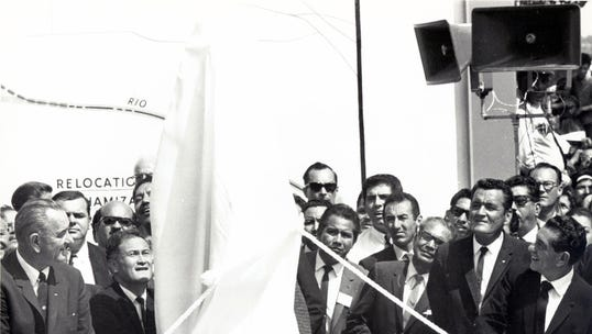 President Lyndon B. Johnson, left, and Mexican President Adolfo López Mateos, right, prepare to unveil the shining chrome monument marking the new boundary of Mexico and the United States near Bowie High School in this Sept. 25, 1964, photograph. Following the ceremony, the presidents were given two framed artistic renderings symbolizing settlement of the Chamizal dispute.