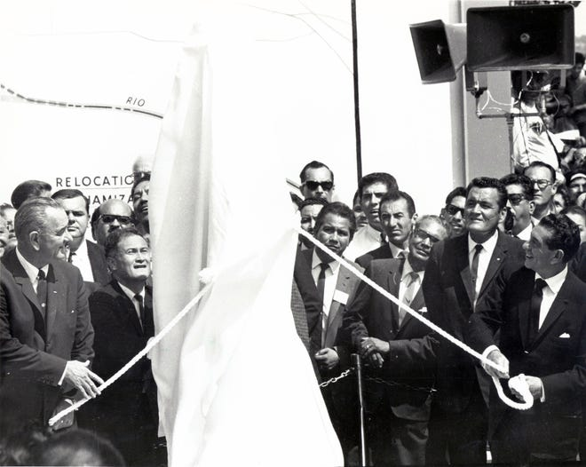 September 25, 1964 - UNVEIL MARKER -- President Lyndon Johnson, left, and Lopez Mateos, right prepare to unveil the shining chrome monument marking the new boundary of Mexico and the United States near Bowie High School.
